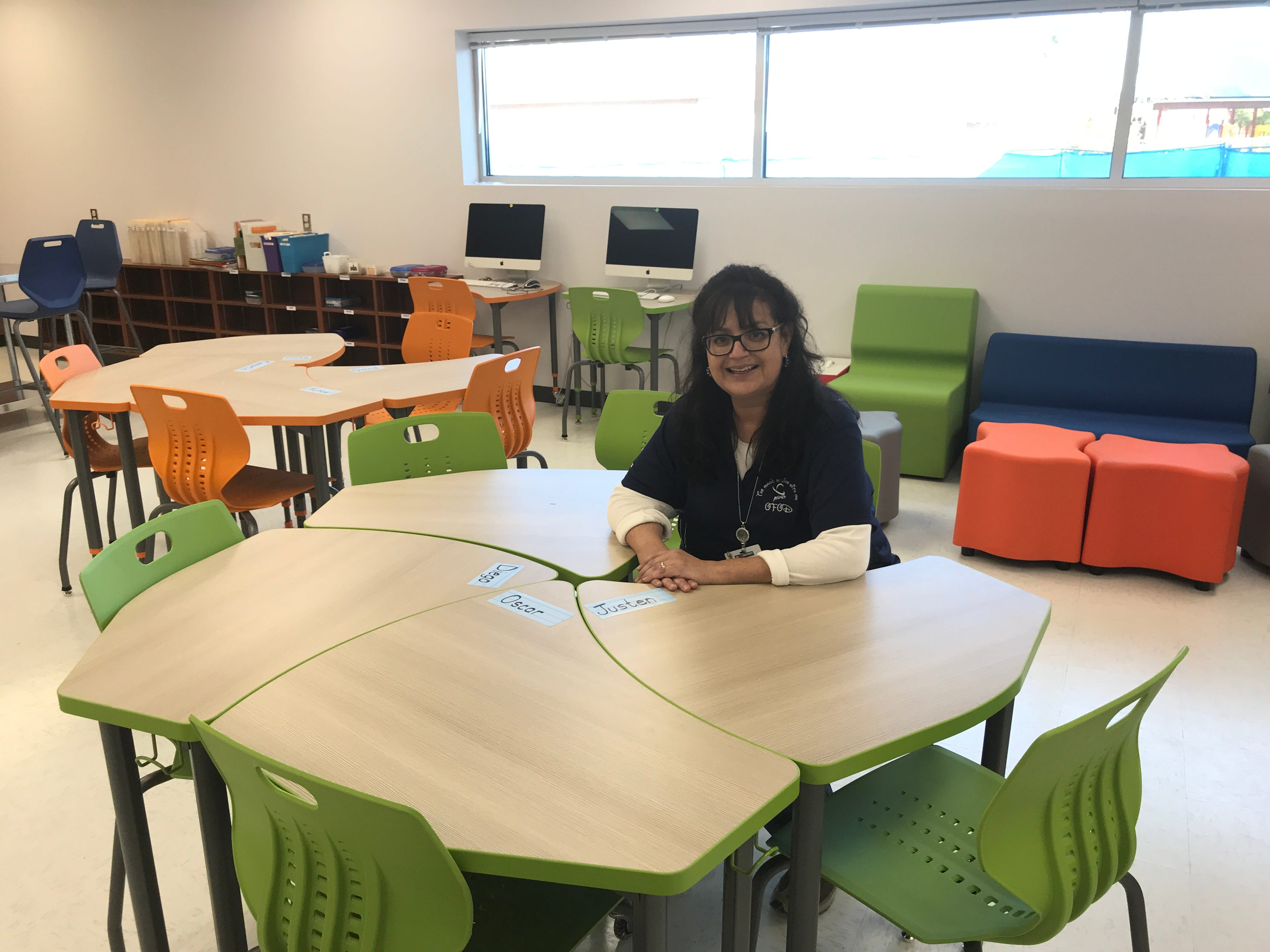 Yoli Marquez, a special education teacher, sits in her new classroom at Del Valle Middle School. The classroom has a kitchen, handicapped bathroom and laundry area to help serve special needs students better.