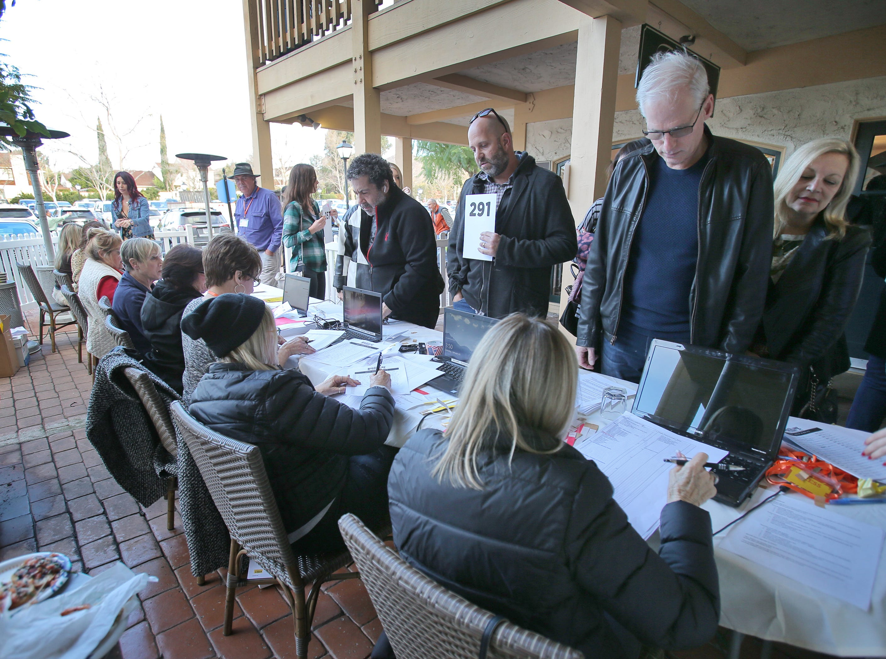 Guests check in at the We Are Borderline Strong benefit on Sunday at Boccaccio's Restaurant, The Westlake Yacht Club and The Landing in Westlake Village.