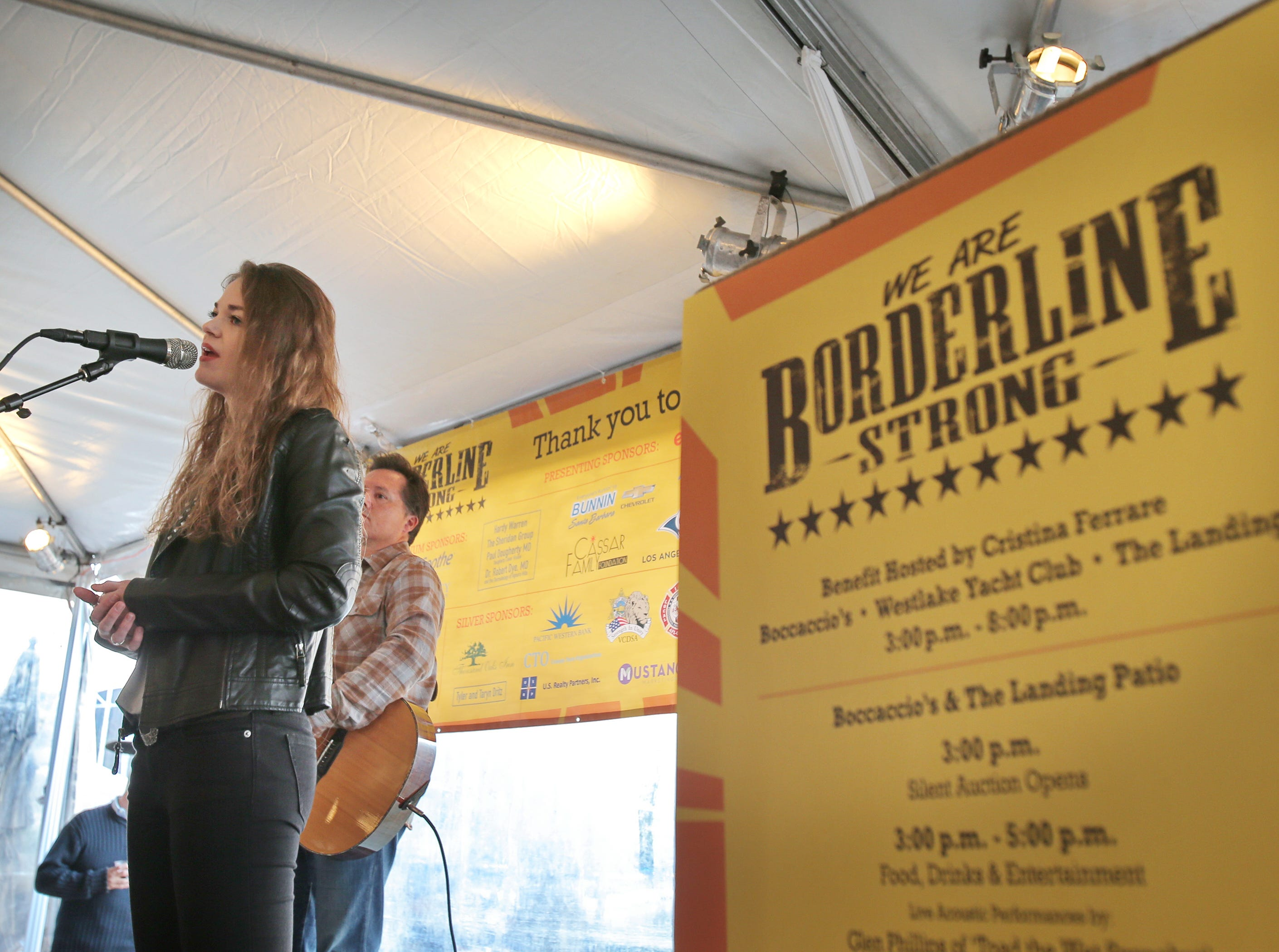 """Local artist Paige Peel, of Moorpark, accompanied by Joel Jacks, performs her song """"Our Home"""" during Sunday's We Are Borderline Strong benefit at Boccaccio's Restaurant, The Westlake Yacht Club and The Landing in Westlake Village. Peel wrote the song for her two brothers who lost friends at the Borderline shooting."""