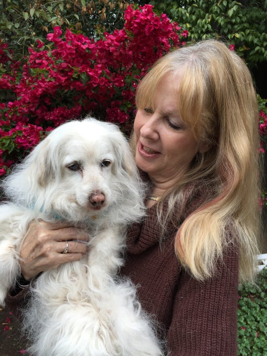 Wendy Dale Young, who adopted Saddam Hussein's dog after it was rescued by U.S. Marines, will sign copies of her book Jan. 12 in Ventura.