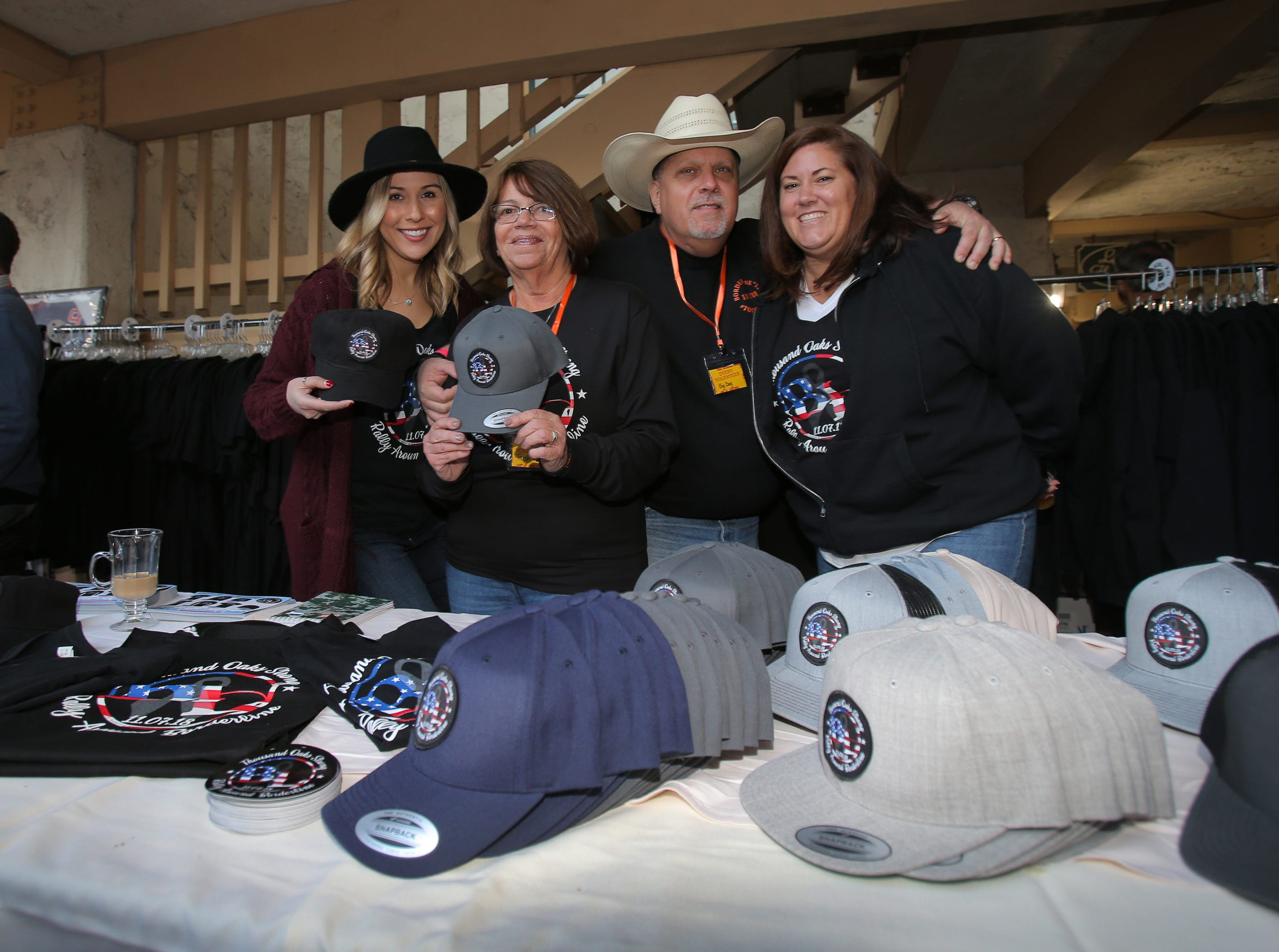 """American Cancer Society's Christine Trunick, from left, Trish Kuehl, John Short and Stacy Radke are just four of the many volunteers who helped out during the We Are Borderline Strong benefit at Boccaccio's Restaurant, The Westlake Yacht Club and The Landing in Westlake Village on Sunday. They were selling jackets, T-shirts and hats that read """"Thousand Oaks Strong; Rally Around Borderline."""" More than 800 guests attended the event that included food and drink and live entertainment provided by many local artists. All of the funds raised will go directly to the victims' families and survivors."""