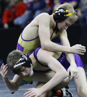 Cody Holmes, top, is one of a pair of Two Rivers individuals who are ranked first in their weight classes in Divsion 2 in the latest Wisconsin Wrestling Online state poll.