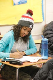 Marie L. Gabriel of Spring Valley goes over some notes during a social studies class at the Rockland BOCES for Adult Education in Nyack on Jan. 7, 2019.