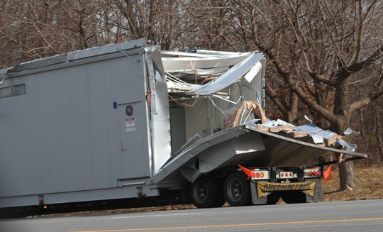 The rear of the truck that hit an overpass on northbound I-684 at the I-84 interchange in the town of Southeast sits on the side of the road on Jan. 7, 2019.
