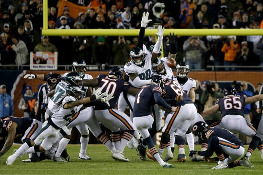 Chicago Bears kicker Cody Parkey (1) attempts a field goal during the second half of an NFL wild-card playoff football game against the Philadelphia Eagles Sunday, Jan. 6, 2019, in Chicago. The attempt has since been ruled a blocked field goal by the NFL.