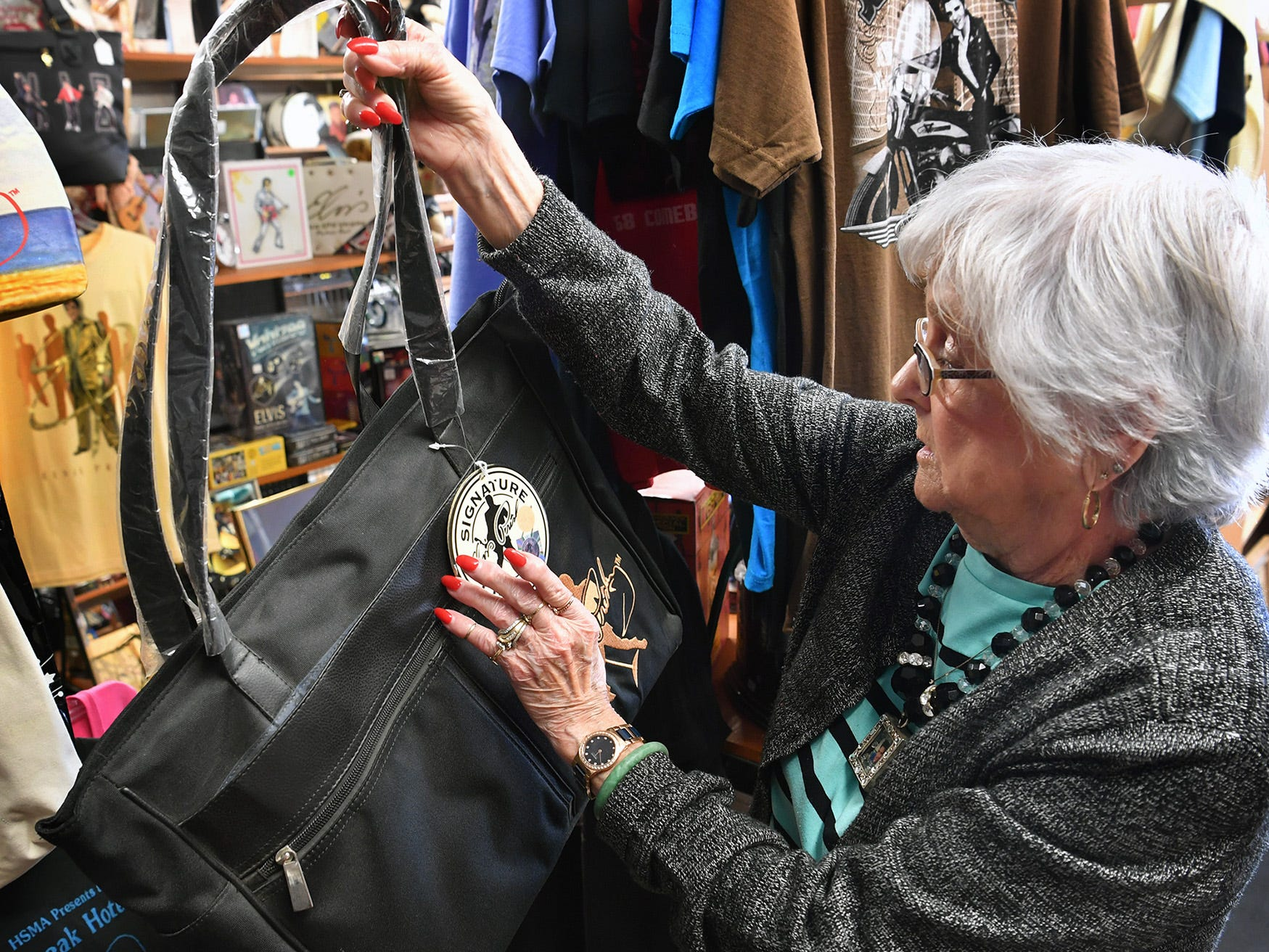 Margaret Waller shows one of the wide variety of products collectors of Elvis memorabilia can find at the the shop she and her husband operate, Elvis Always Gifts and Collectibles.