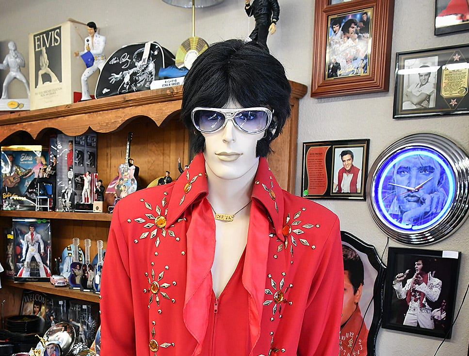 The Elvis Always Gifts and Collectibles store includes an Elvis costume complete with sideburns. Elvis Presley was born on January 8, 1935 and died August 16, 1977.