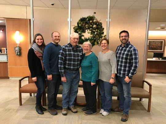 Bob and Susan Manzke with their family (from left) Rachel, Russ, Rebecca, and Rob at the oncologist's office.
