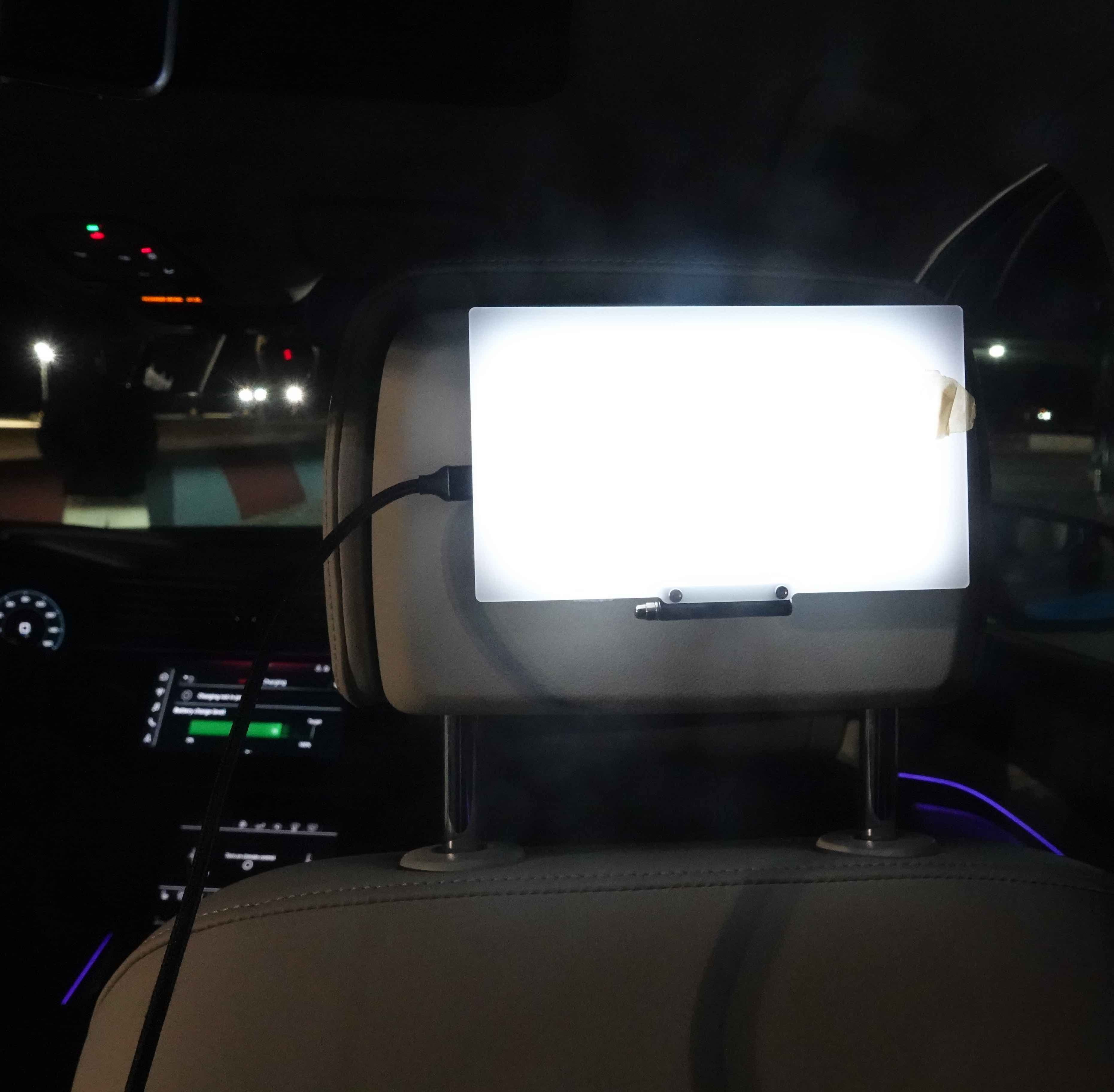 Backseat of Audi E-Tron car, rigged up with Virtual Reality viewer