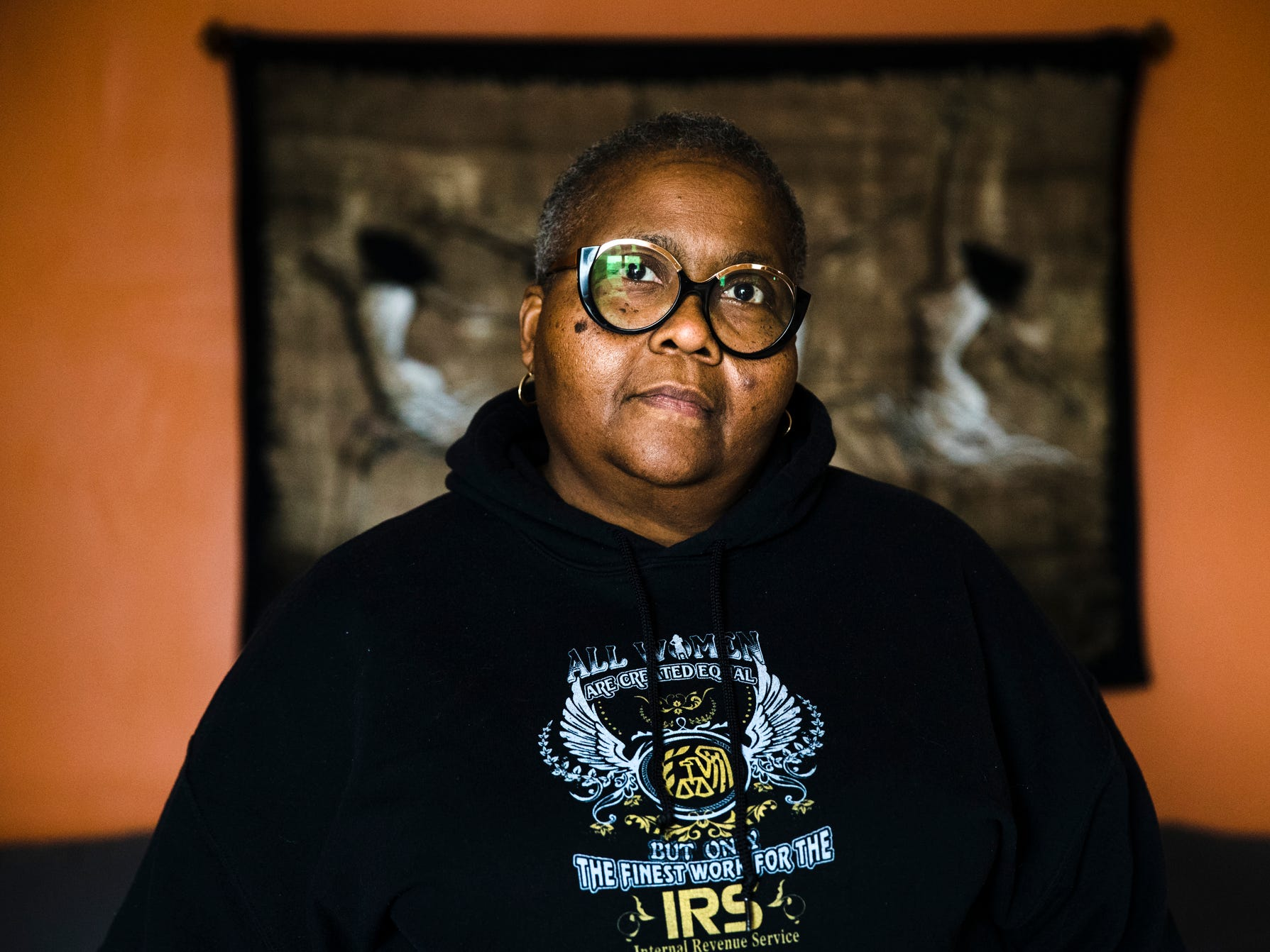 Nora Brooks a furloughed customer service representative for the Internal Revenue Service poses for a photograph at her home in Philadelphia, Jan. 3, 2019.   Brooks has been furloughed, worrying about whether she will need to seek a second job. The agency requires pre-approval to avoid conflicts of interest, but there's no one in the office to sign off.