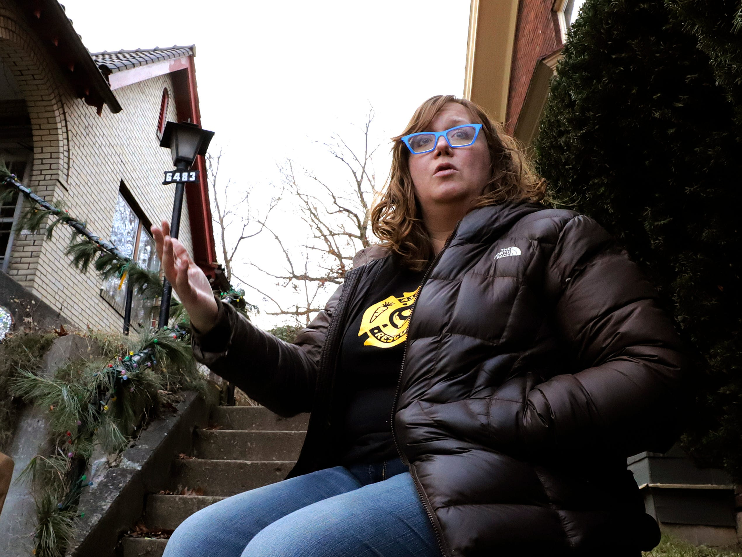 Rebecca Maclean, a housing program specialist for the U.S. Department of Housing and Urban Development in Pittsburgh, sits outside her home in Pittsburgh, Jan. 3, 2019. Maclean, 41, has been on furlough since Dec. 21.  Her family's financial outlook isn't dire yet since her husband, Dan Thompson, owns a knife-making business and works as an elected constable. But the couple recently sat down to prioritize which bills must be paid on time and which can be paid late without dinging their credit history.