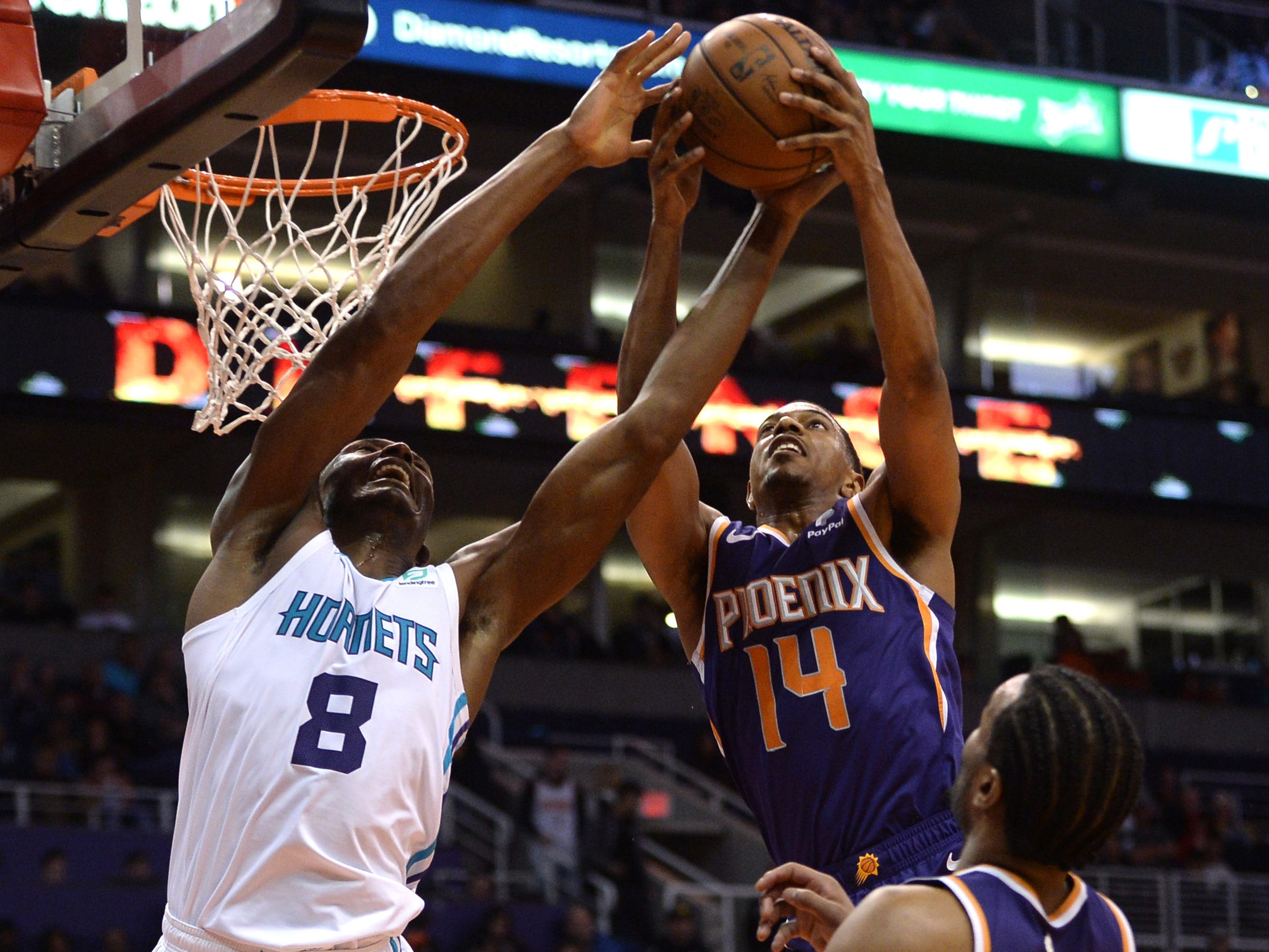 Jan. 6: Hornets center Bismack Biyombo (8) fights for a rebound against Suns guard De'Anthony Melton (14) during the second half in Phoenix.