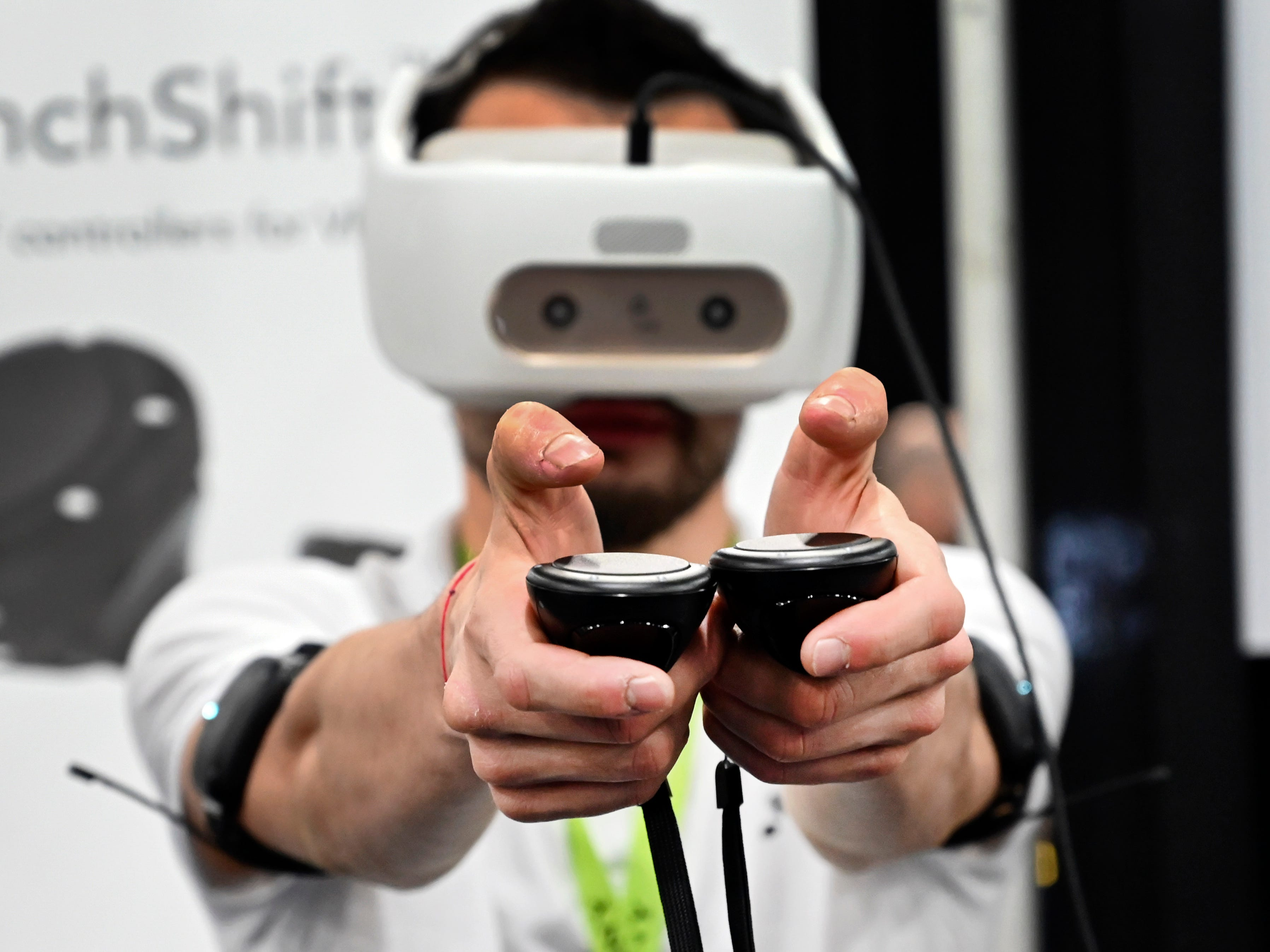 January 6, 2019; Las Vegas, NV, USA;  Vitalii Ivanov of Finch Technologies from the Russian Federation, demonstrates the company's Finchshift Controllers at CES Unveiled, a media preview event at the Mandalay Bay Convention Center. Finchshift Controllers allow tracking of hands and body. Mandatory Credit: Robert Hanashiro- USA TODAY NETWORK ORIG FILE ID:  20190106_ajw_usa_981.jpg