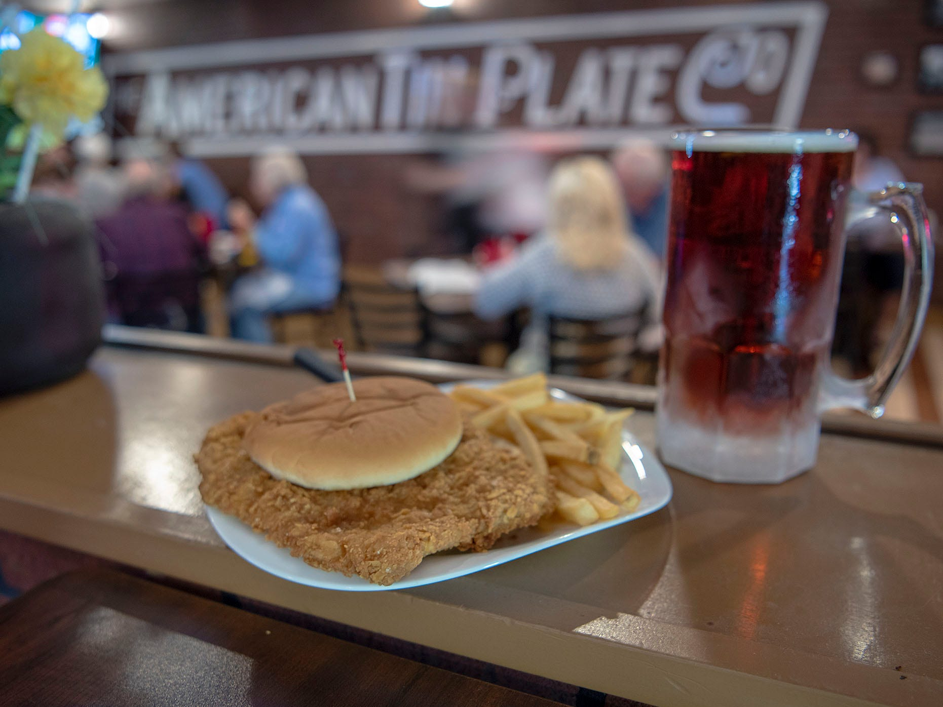 "The Tin Plate's pork tenderloin is a 10-ounce, center-cut loin chop pounded thin and dredged in tasty coating. ""We're a small-town place, but we sold just shy of 20,000 tenderloins last year,"" said owner Patrick Rice Jr."