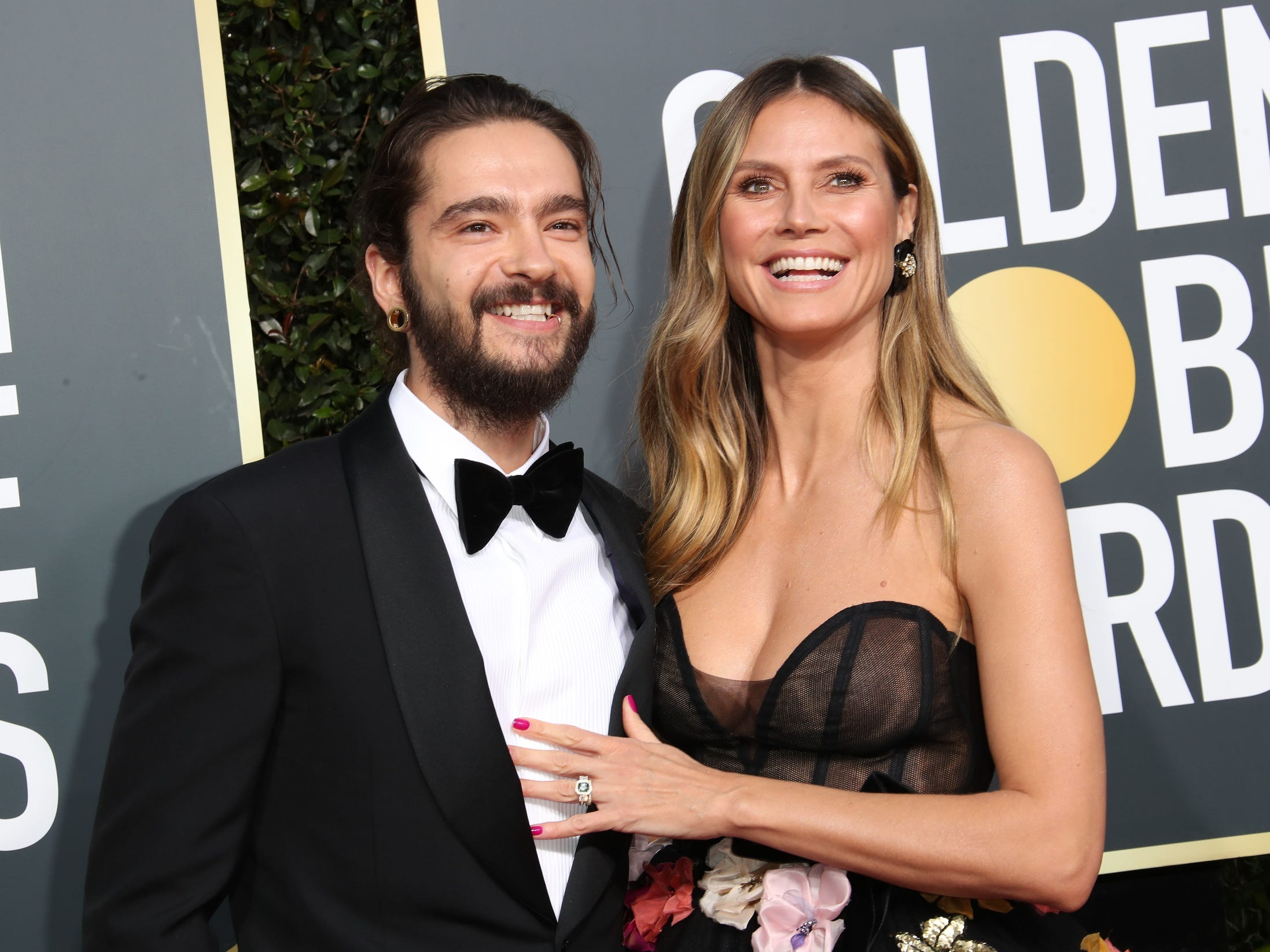 Tom Kaulitz and Heidi Klum arrive.