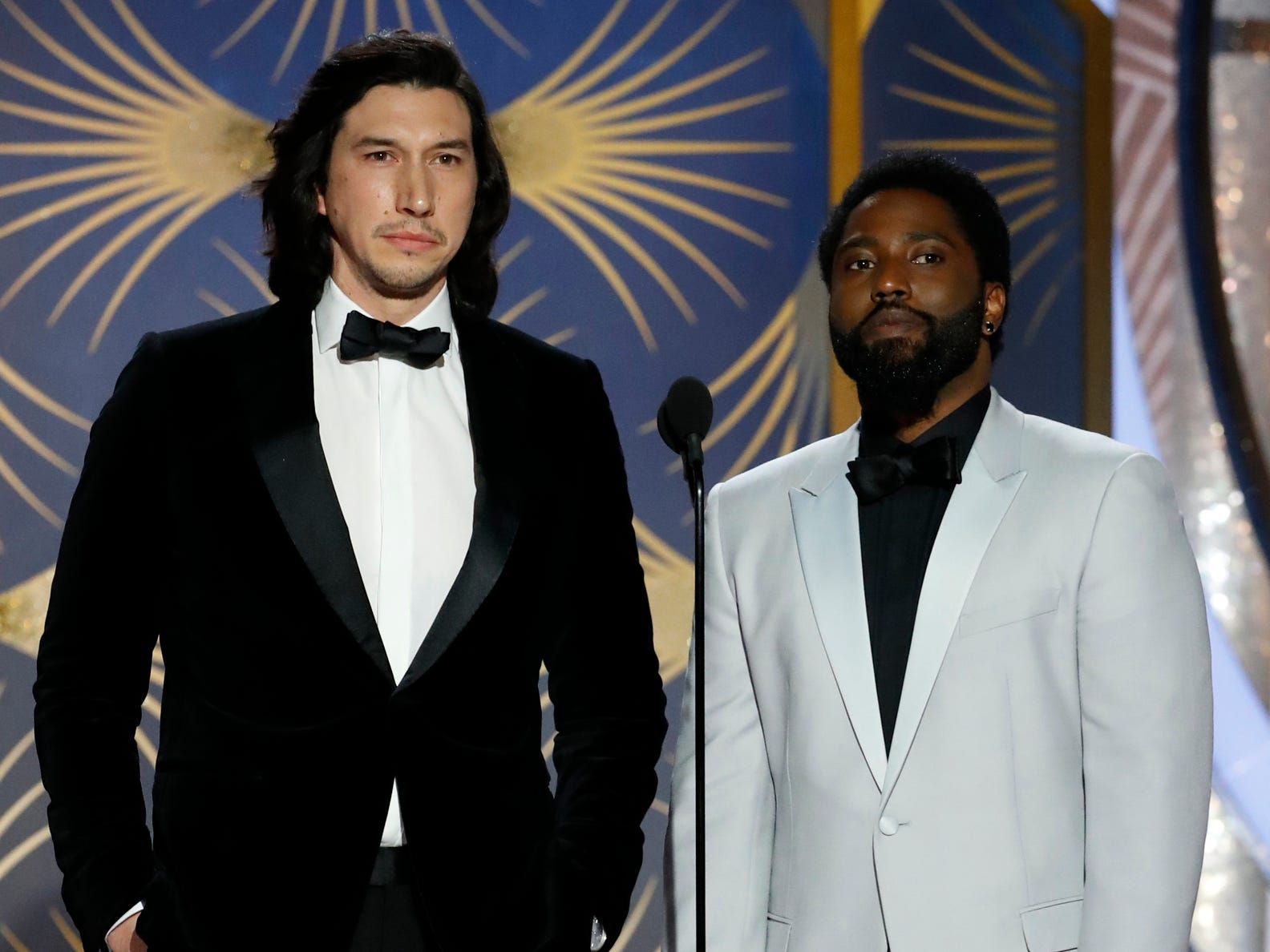 Adam Driver and John David Washington present during the 76th Golden Globe Awards.