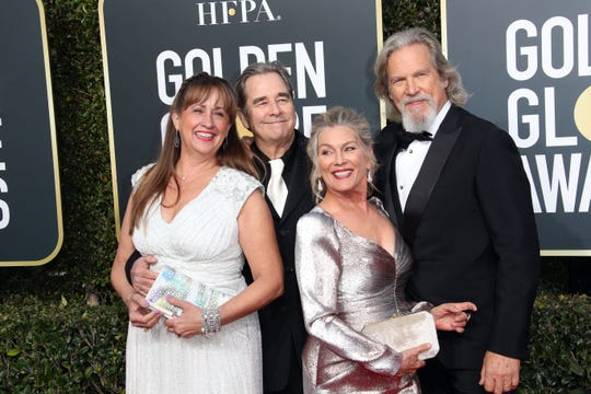 The Bridges family turned out to celebrate Jeff Bridges receiving the Golden Globes' Cecil B. DeMille Award: Brothers Beau and Jeff, back, with wives Wendy Treece Bridges, front left, and Susan Geston.