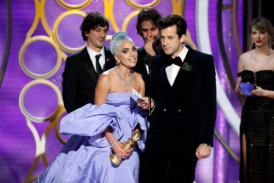 Lady Gaga and Mark Ronson accept the Golden Globe for best original song - motion picture.