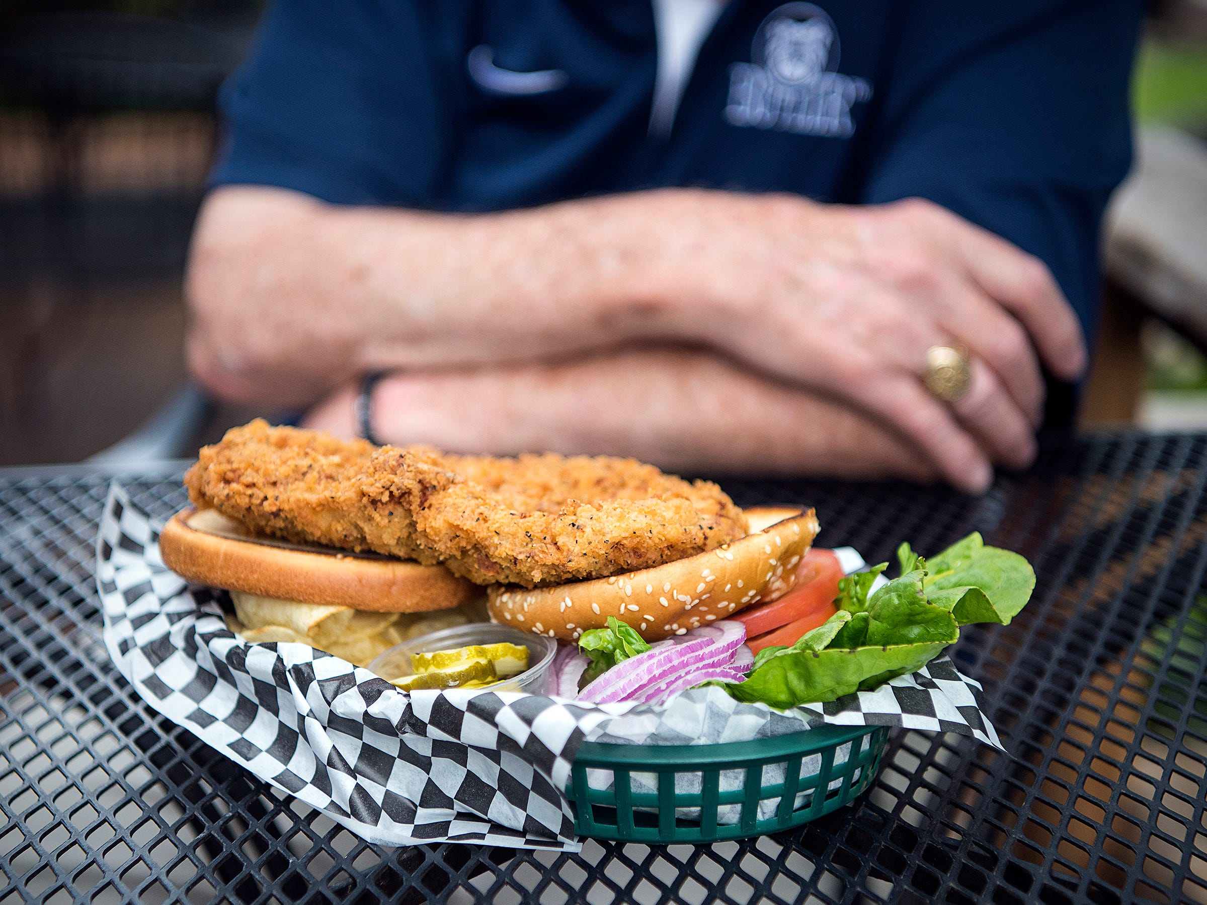 The pork tenderloin sandwich at Plump's Last Shot is a hefty, delicious meal that comes with pickles, red onions, lettuce and a host of condiments. The tenderloin is cut and pounded out in-house, and the breading is a special recipe cooked up by a former chef at the bar.