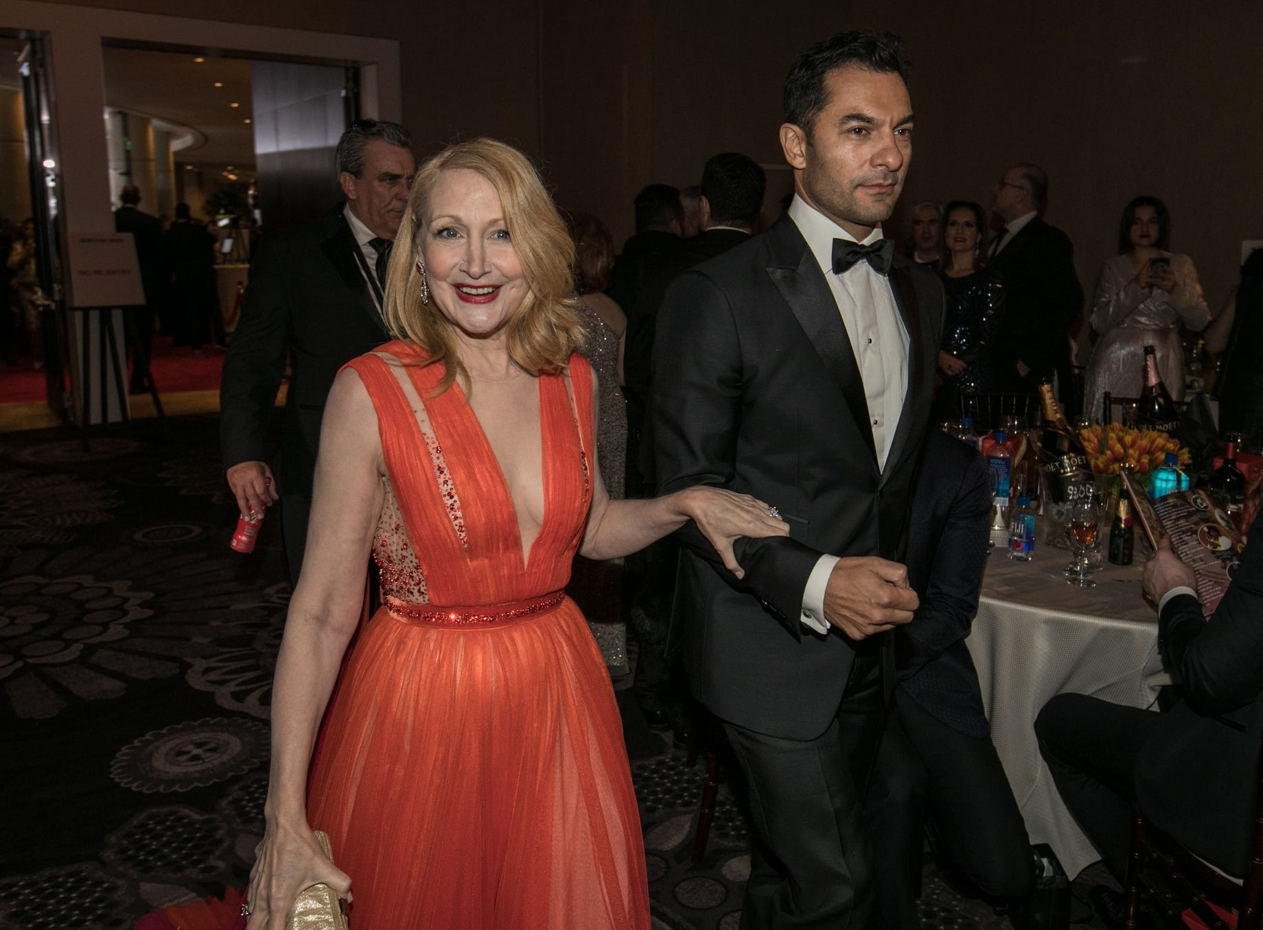 Patricia Clarkson is escorted inside the ballroom.