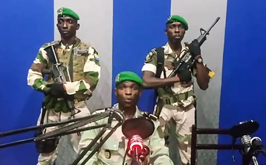 Rebels take over oil-rich Gabon national radio station, say they are overthrowing the government