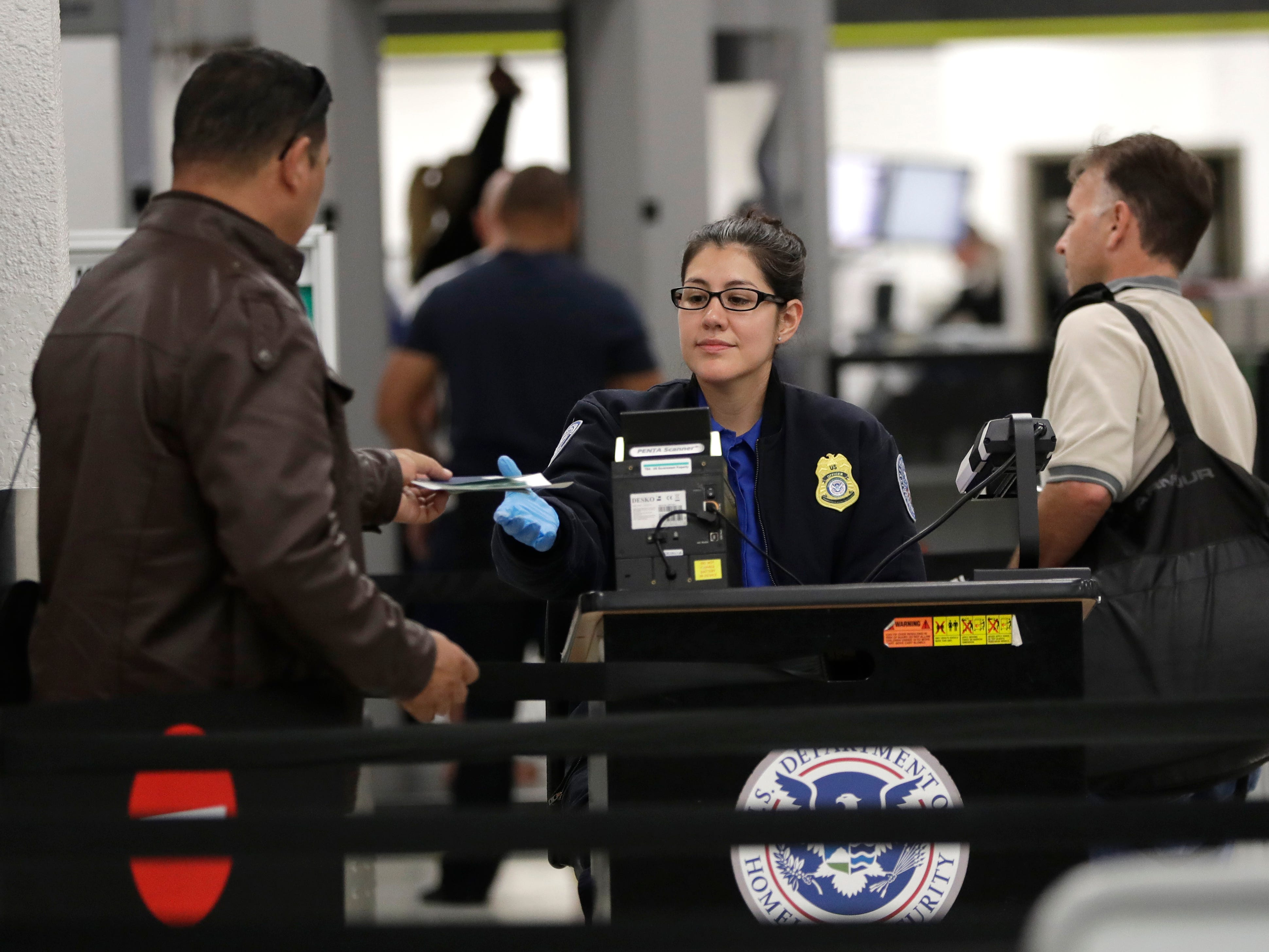 A Transportation Security Administration officer works at a checkpoint at Miami International Airport, Jan. 6, 2019, in Miami. The TSA acknowledged an increase in the number of its employees calling off work during the partial government shutdown.