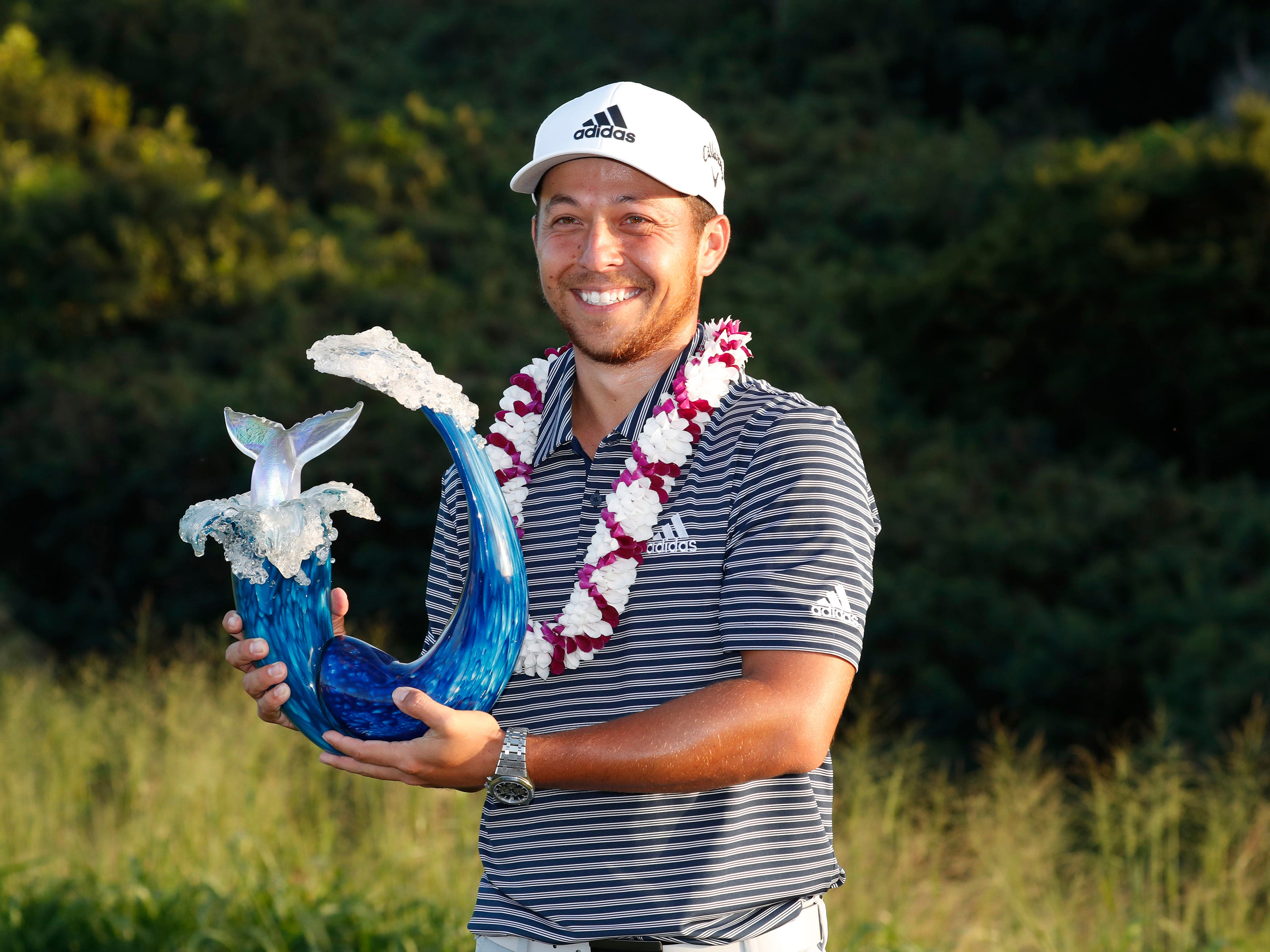 Jan. 6: Xander Schauffele poses with the trophy after winning the Sentry Tournament of Champions golf tournament at Kapalua Resort - The Plantation Course.
