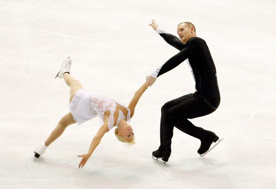 John Coughlin, shown with pairs partner Caydee Denney, competes at the 2013 Skate America competition at Joe Louis Arena.