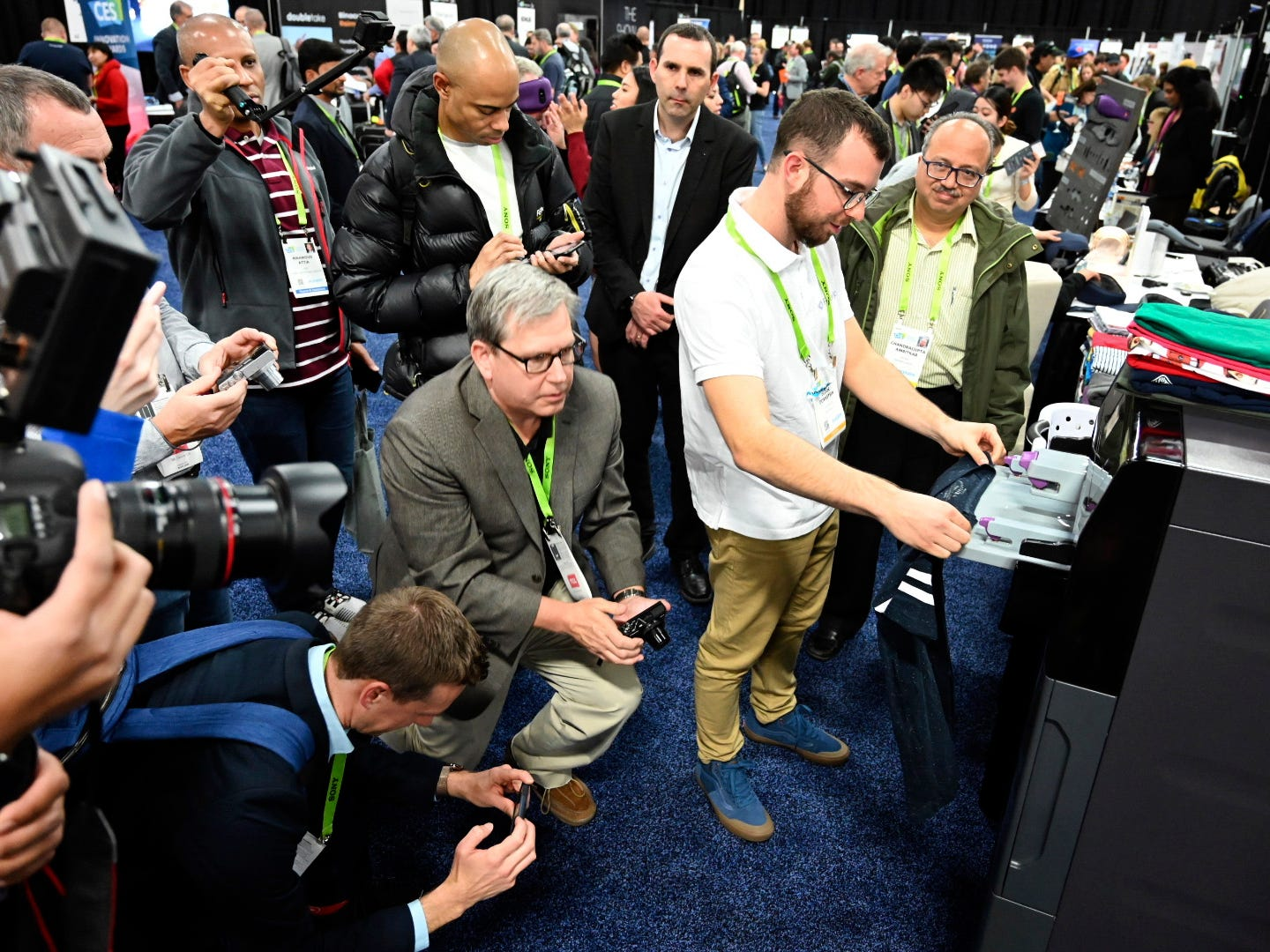January 6, 2019; Las Vegas, NV, USA;  A demonstration of FoldiMate draws a crowd at CES Unveiled, a media preview event at the Mandalay Bay Convention Center. The company says the laundry folding machine can fold a load of laundry in five minutes. Mandatory Credit: Robert Hanashiro- USA TODAY NETWORK ORIG FILE ID:  20190106_ajw_usa_982.jpg