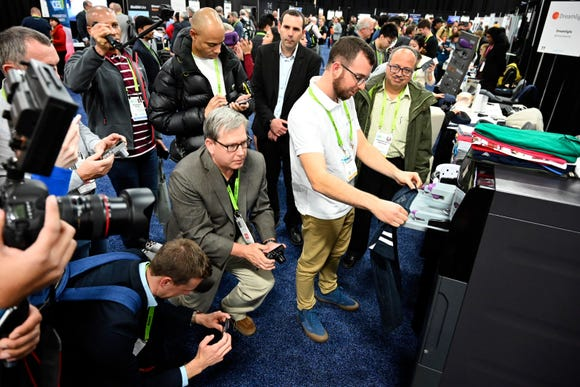 A demonstration of FoldiMate draws a crowd at CES Unveiled, a media preview event at the Mandalay Bay Convention Center. The company says the laundry folding machine can fold a load of laundry in five minutes.