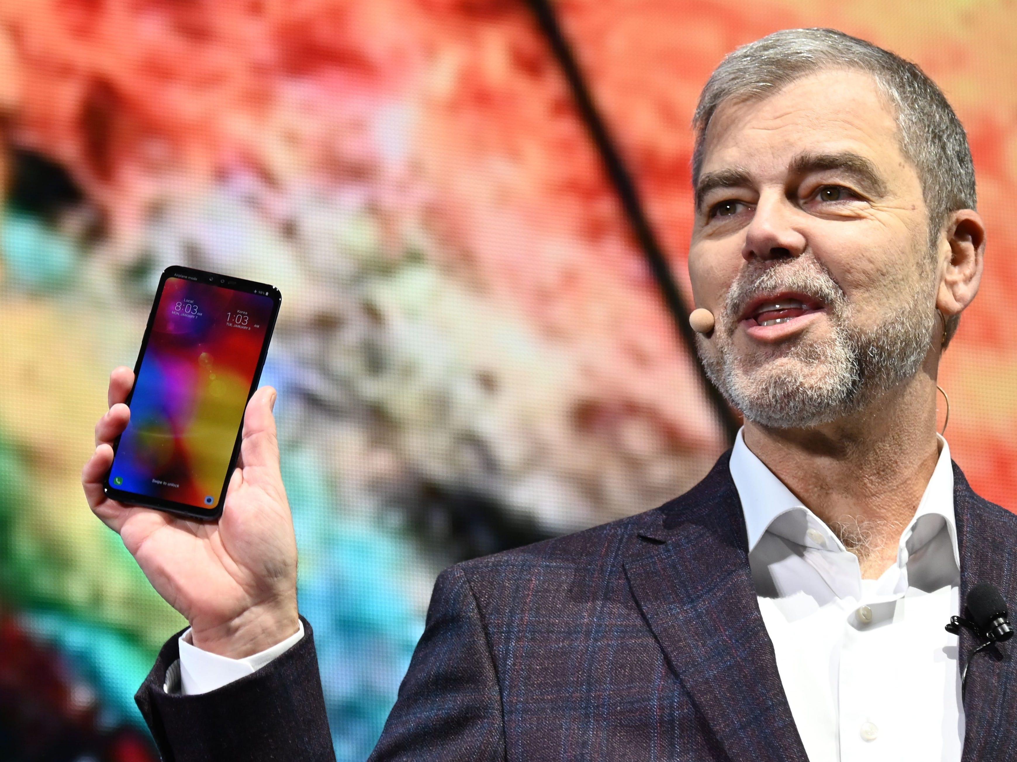 LG Senior VP David VanderWaal holds a LG V40 phone.