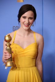 """Rachel Brosnahan holds up the Golden Globe she won for Amazon's """"The Marvelous Mrs. Maisel."""""""