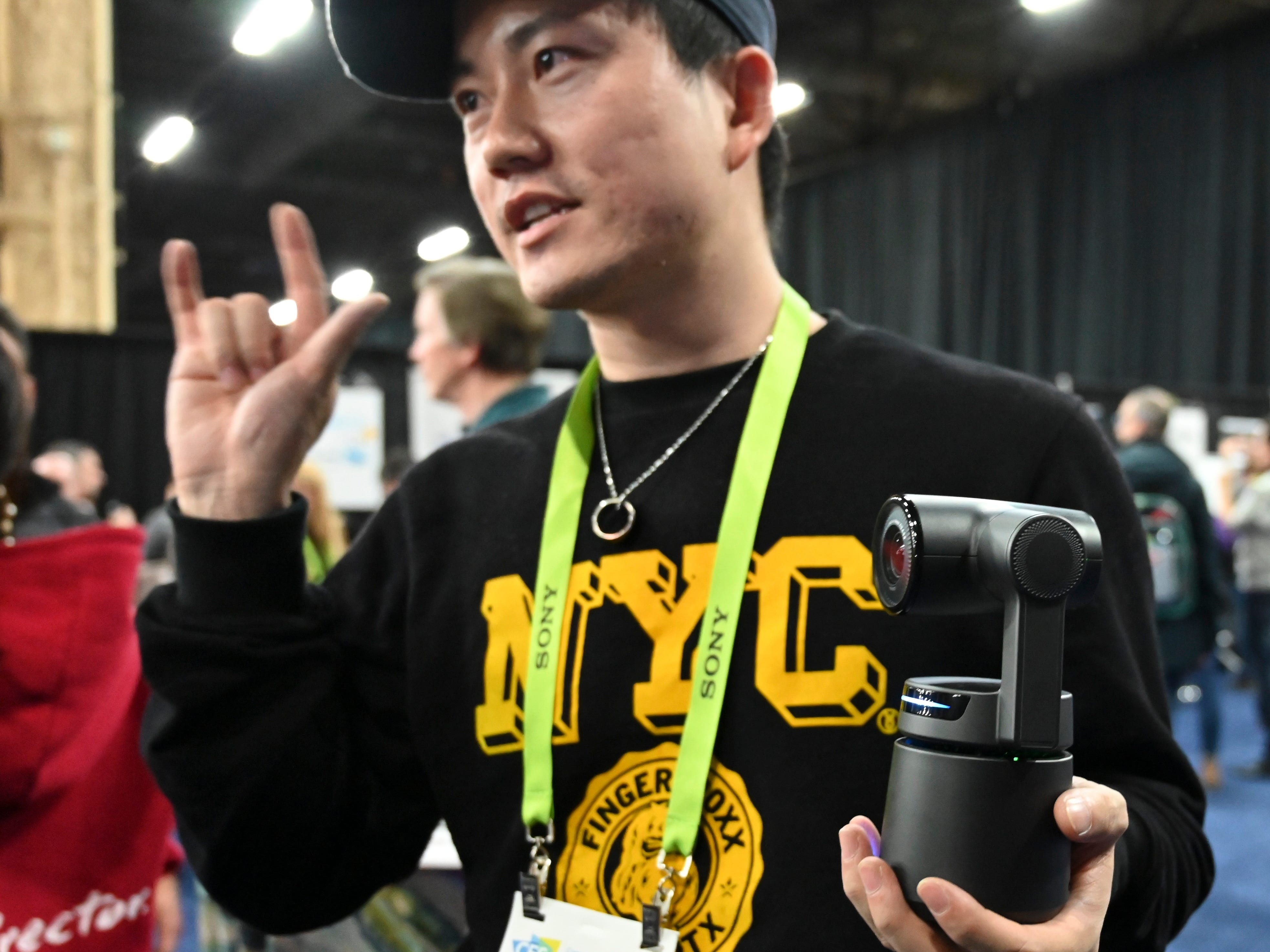 Xin Zhang shows off the Obsbot, an AI-powered camera that can track subject automatically.