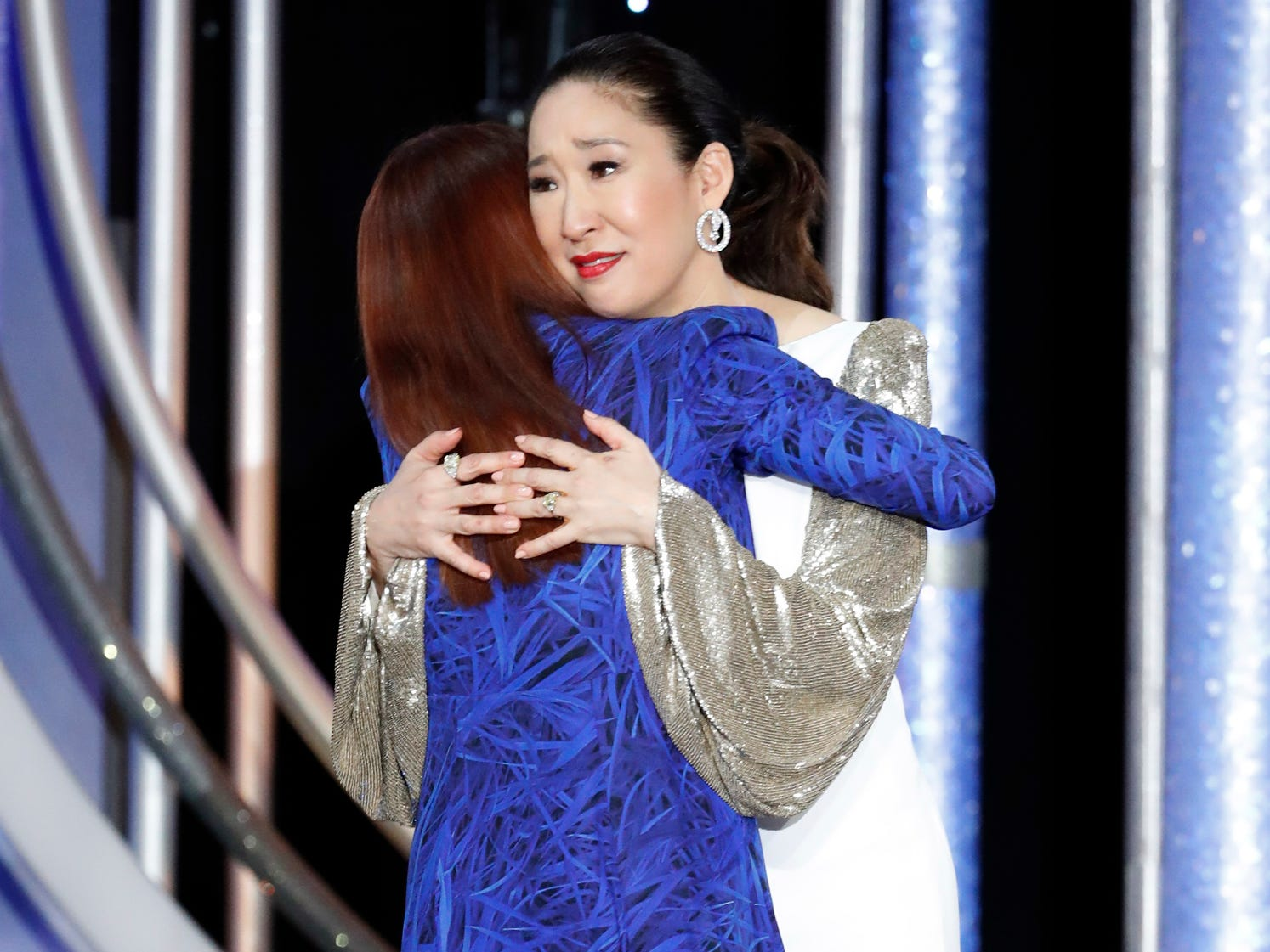 "Megan Mullally, left, hugs Sandra Oh as she accepts the award for Best Actress - TV Series, Drama, for ""Killing Eve"" during the 76th Golden Globe Awards."