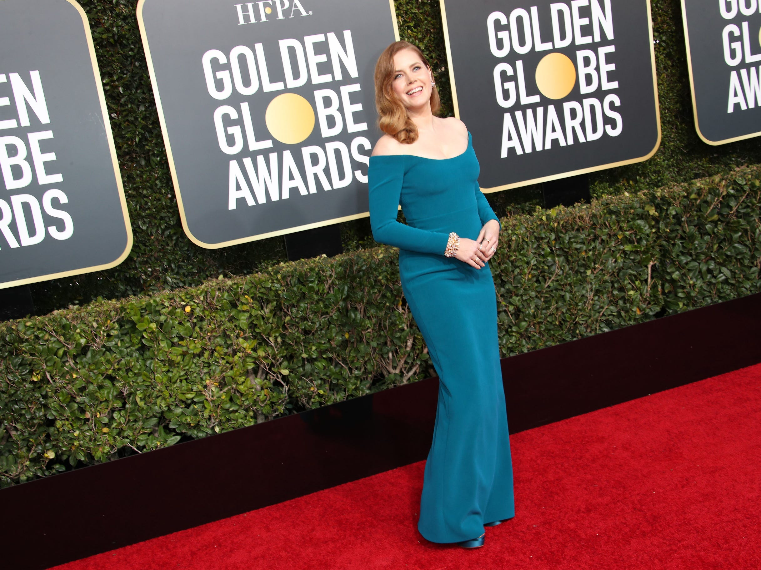 Amy Adams arrives.