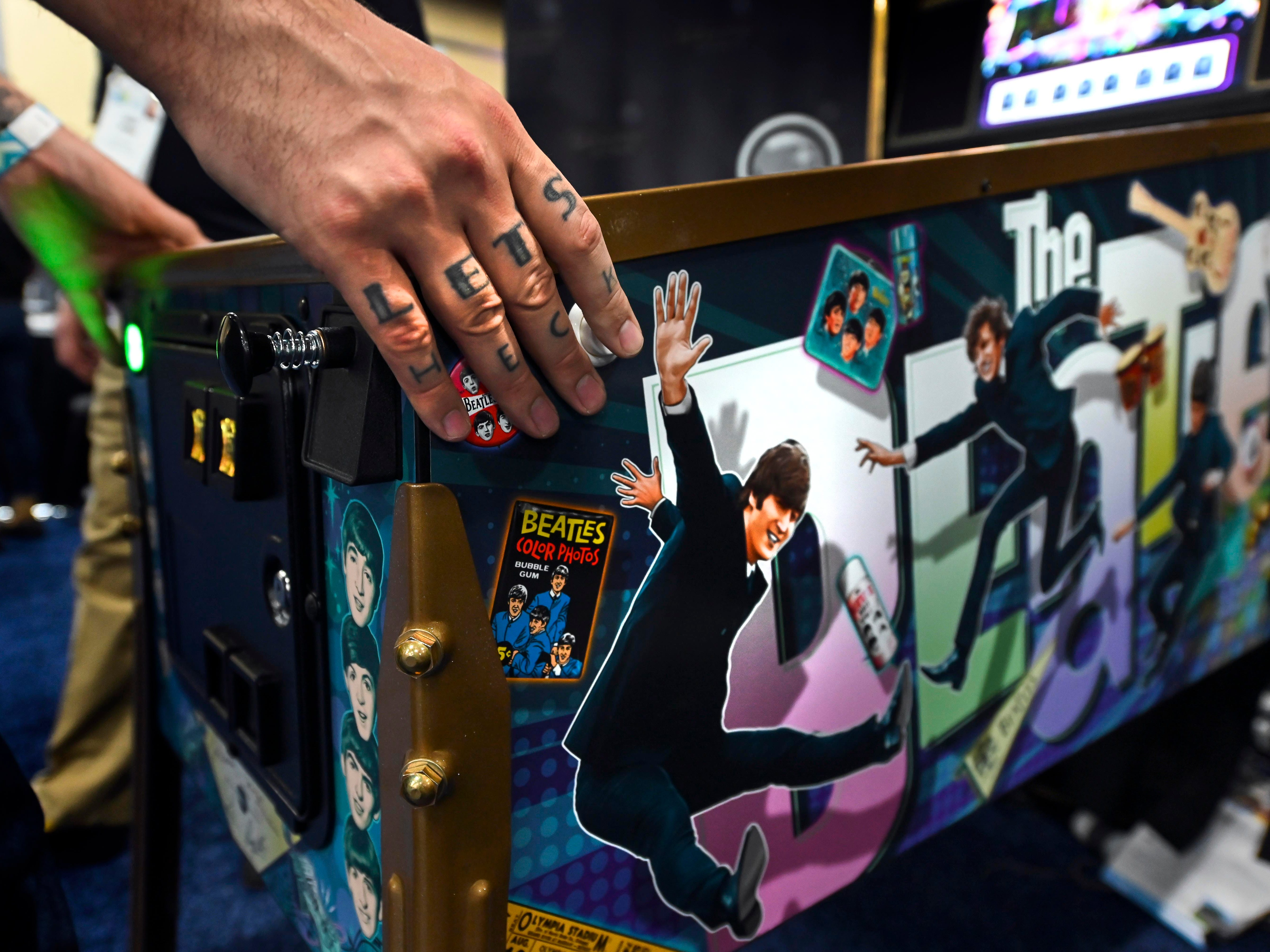 January 6, 2019; Las Vegas, NV, USA;  Jack Danger plays Stern Pinball's latest game based on The Beatles at CES Unveiled, a media preview event at the Mandalay Bay Convention Center. The pinball machine features nine hit Beatles song plus audio from John, Paul, George and Ringo. Mandatory Credit: Robert Hanashiro- USA TODAY NETWORK ORIG FILE ID:  20190106_ajw_usa_975.jpg