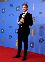 Richard Madden holds the award for Best Performance by an Actor in a Television Series - Drama at the Golden Globes.