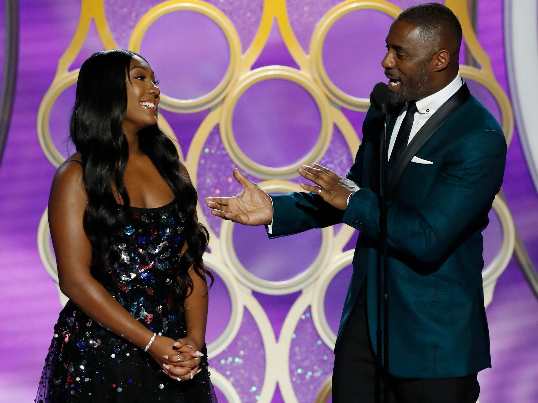 Isan Elba, left and Idris Elba talk on stage during the 76th Golden Globe Awards.