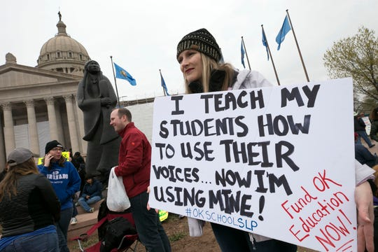 Teacher strikes have been common across the country in the last year. Here, elementary speech language pathology teacher Amber Epperson from Oklahoma City strikes with other Oklahoma teachers at the Oklahoma State Capitol in April. David Wallace/The Republic via USA TODAY NETWORK ORIG FILE ID:  20180402_gma_usa_182.jpg