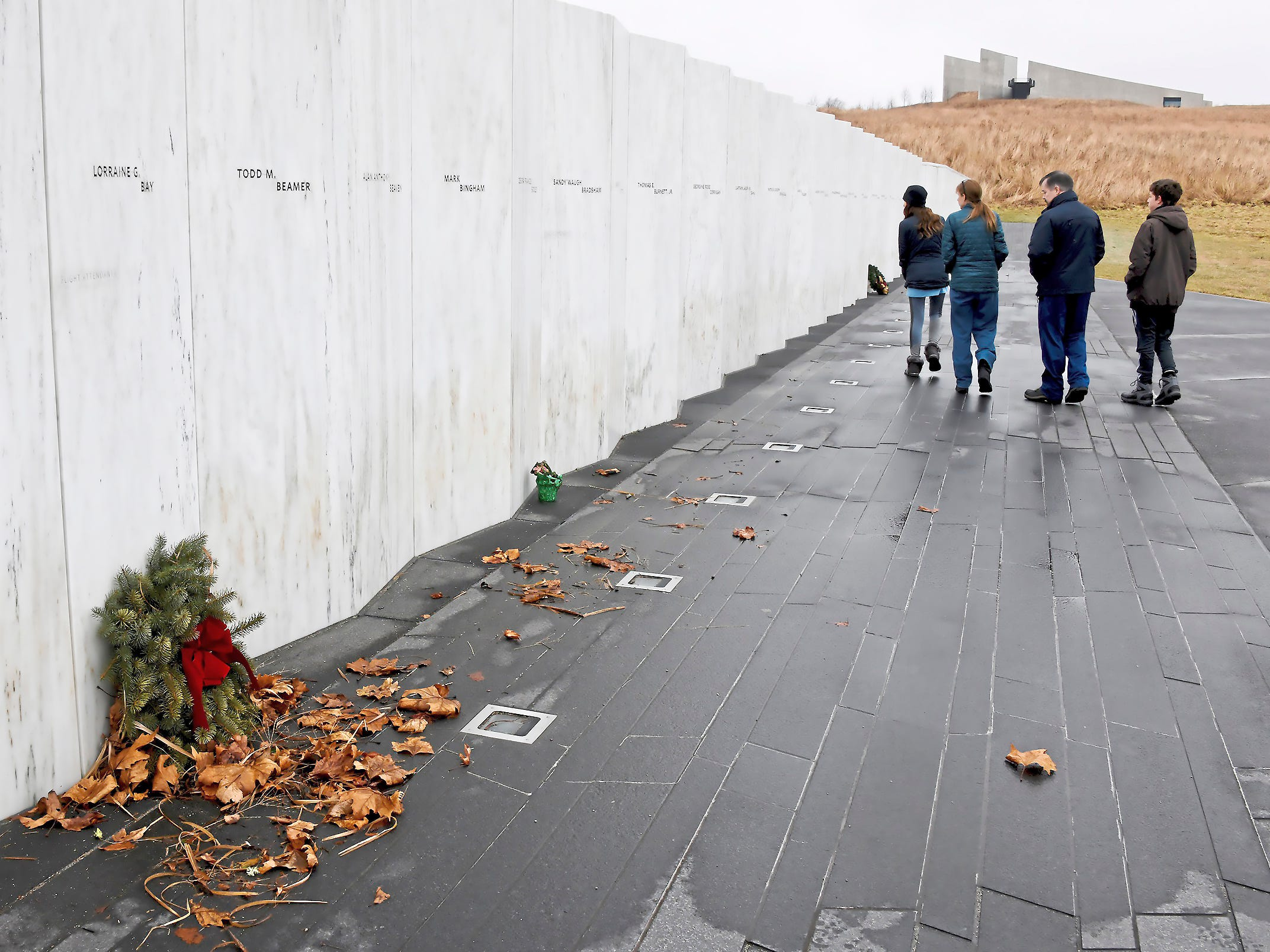 Visitors walk past the Wall of Names at the Flight 93 National Memorial near Shanksville, Pa. on Jan. 2, 2019. Signs were posted on all doors stating that the facilities were closed because of the government shutdown, but that the grounds are open from sunrise to sunset.