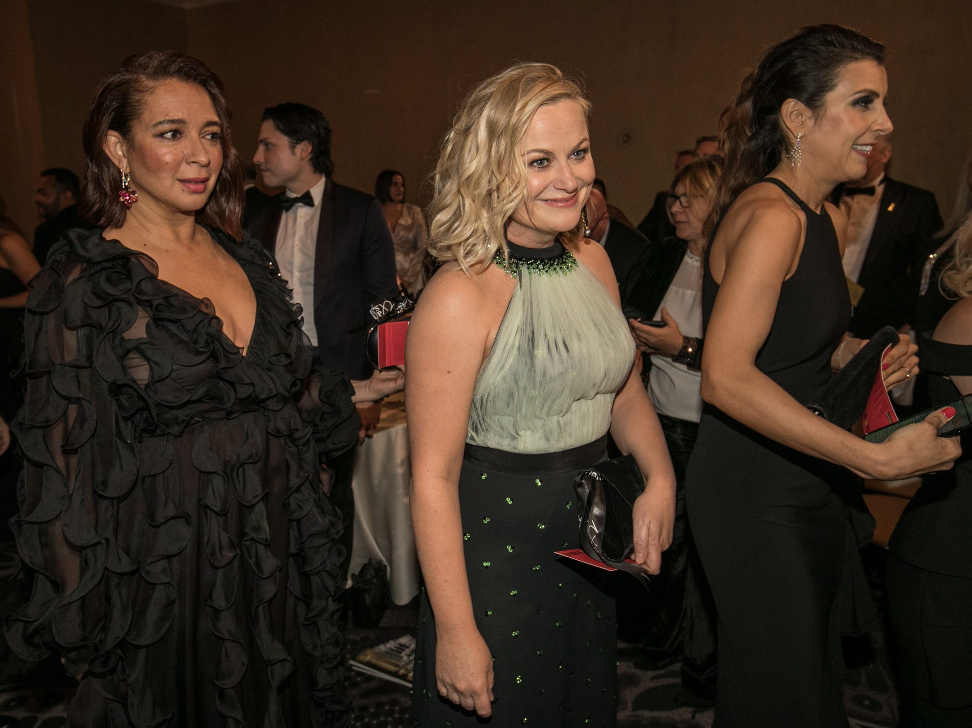 """Saturday Night Live"" alums and Globes presenters Maya Rudolph, left, and Amy Poehler stick close before the show."