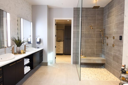 In the Projekt master bathroom, the mirror is a smart device, and smart appliances are sprinkled throughout.
