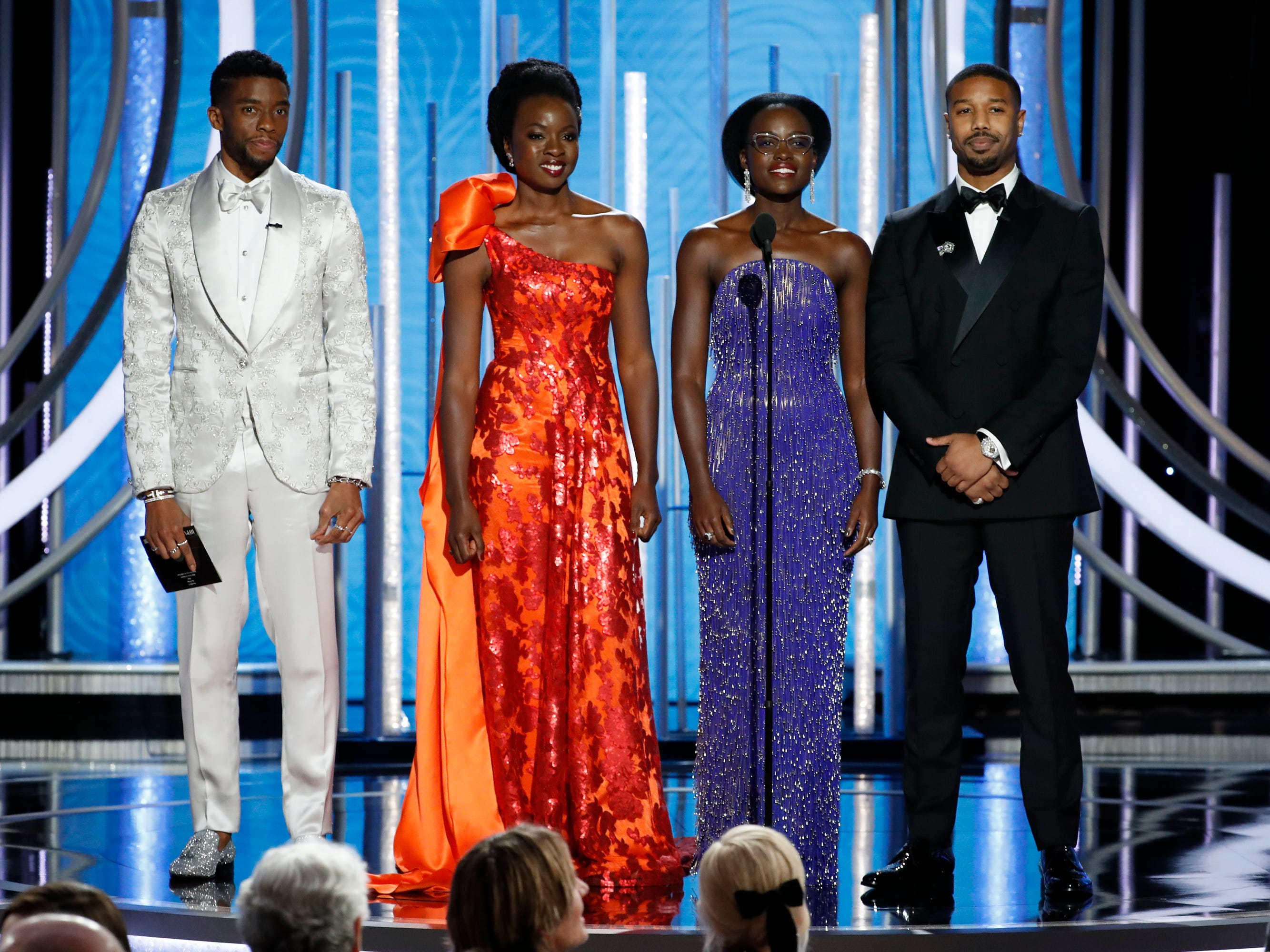 Presenters Chadwick Boseman, Danai Gurira, Lupita Nyong'o and Michael B. Jordan speak onstage during Golden Globe Awards.