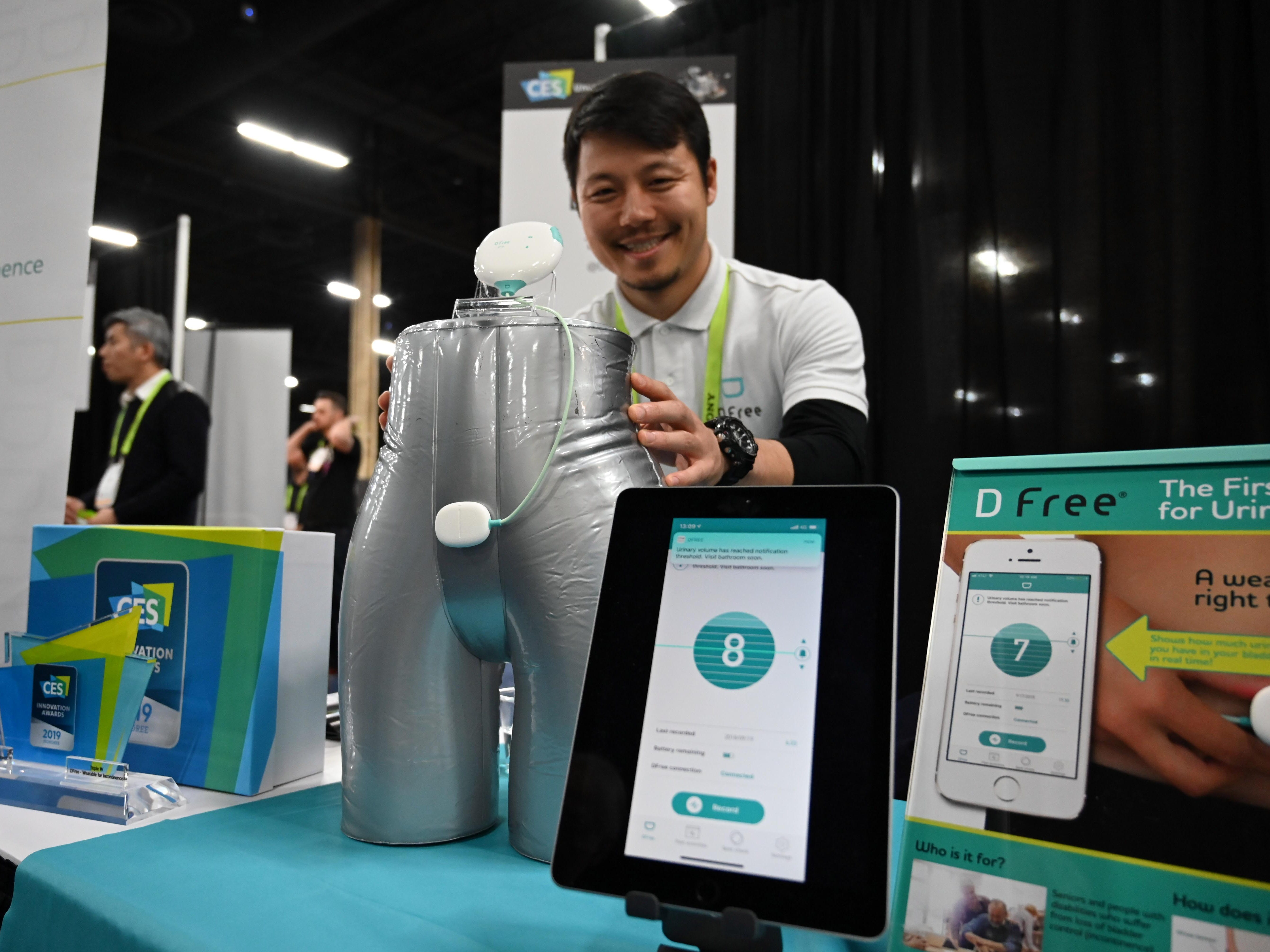 January 6, 2019; Las Vegas, NV, USA;  Atsushi Nakanishi with his product, DFree at CES Unveiled, a media preview event at the Mandalay Bay Convention Center. DFree is the first wearable device for incontinence, the company says. DFree detects the changes in bladder size and predicts urination timing. Mandatory Credit: Robert Hanashiro- USA TODAY NETWORK ORIG FILE ID:  20190106_ajw_usa_966.jpg