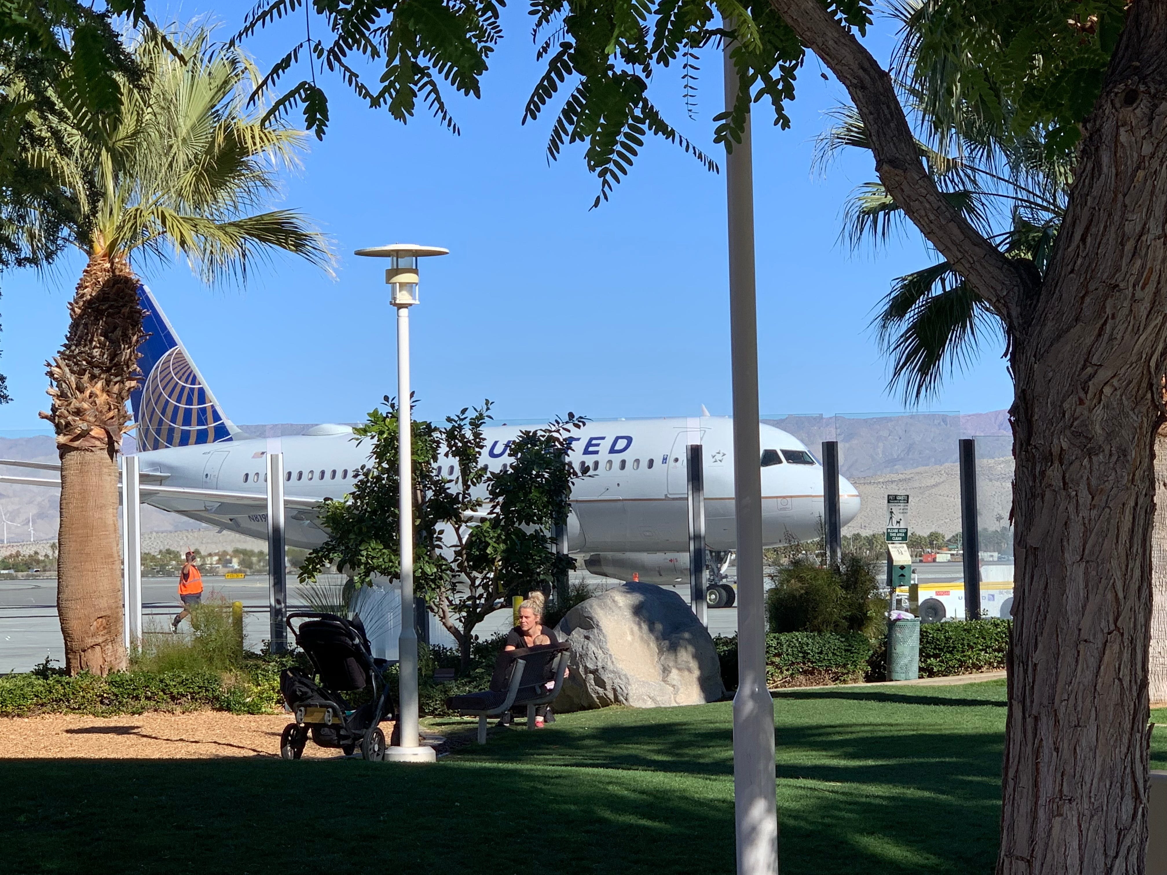 A United Airbus A319 pulls up to the open-air terminal at Palm Springs International Airport in California on Jan. 2, 2019.