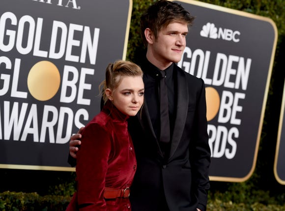 """Director/comedian Bo Burnham, right, who walked the Globes carpet with his """"Eighth Grade"""" star Elsie Fisher, is cutting out late night pizza."""