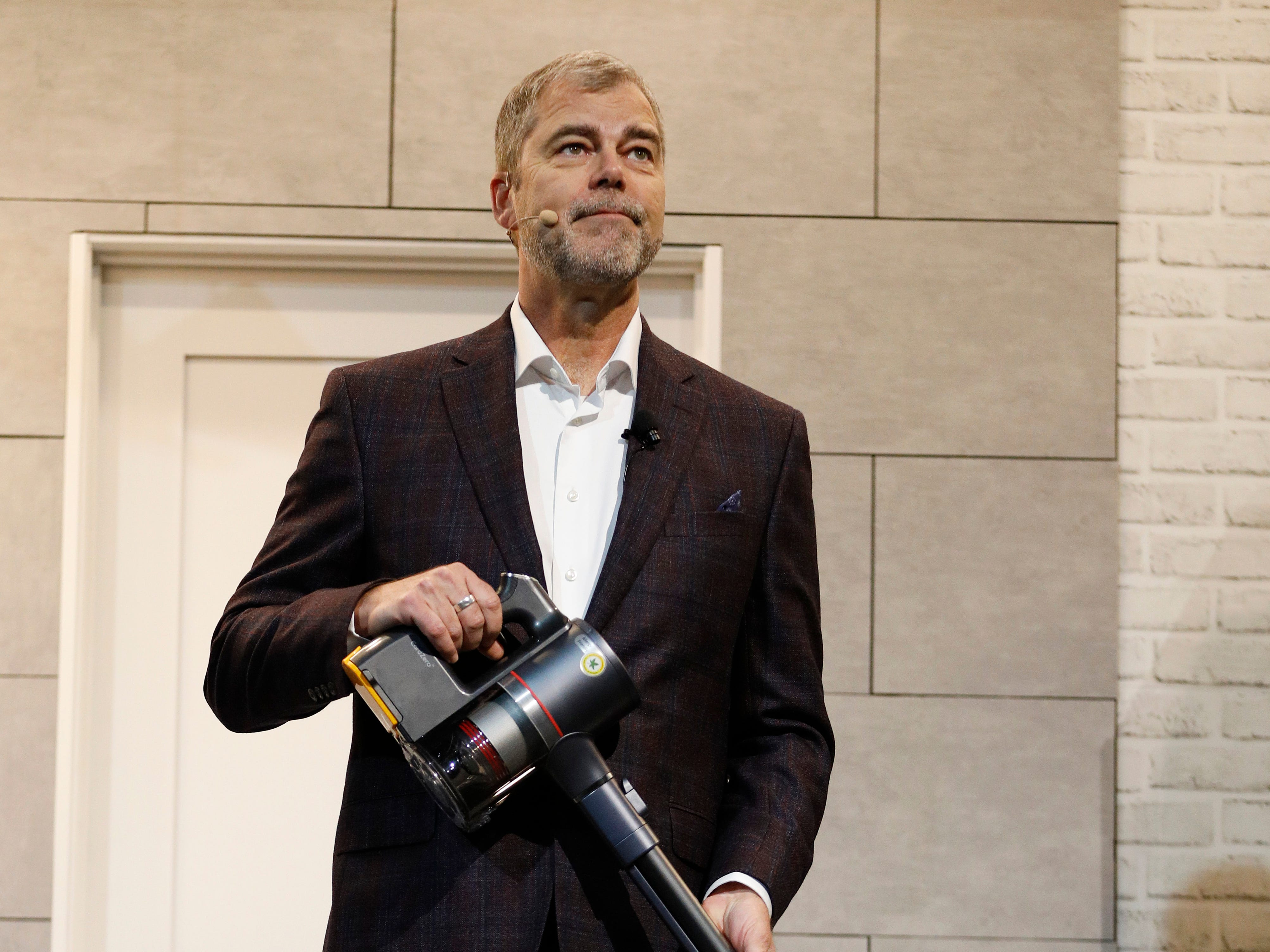 David VanderWaal, vice president of marketing for LG Electronics holds a CordZero A9 Stick Vacuum.