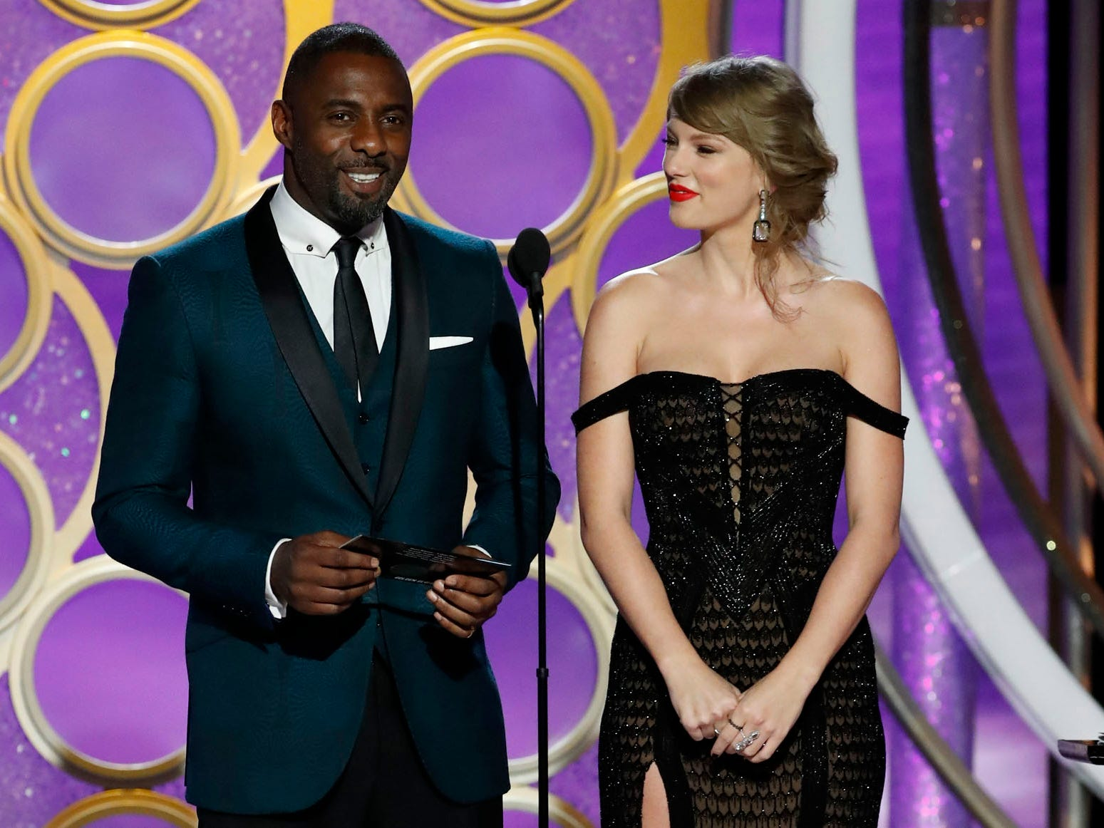 Idris Elba and Taylor Swift present during the 76th Golden Globe Awards.