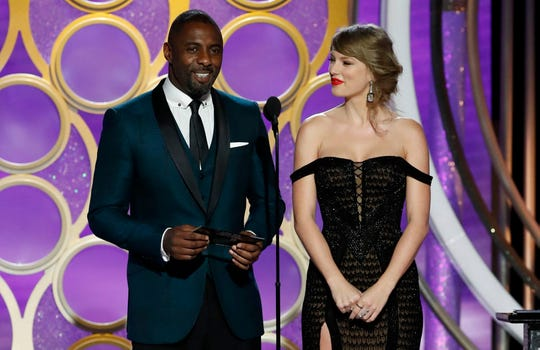 In addition to presenting an award, Idris Elba was the proud papa of this year's Golden Globes Ambassador. And Taylor Swift gave fellow singer/songwriter Lady Gaga a congratulatory hug.