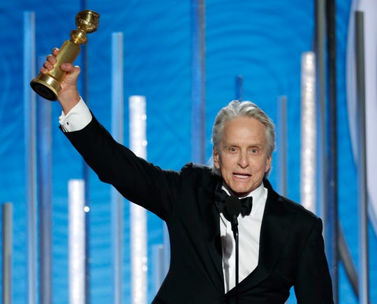 "Michael Douglas, a best actor winner for TV's ""The Kominsky Method,"" dedicates his Golden Globe to dad Kirk."